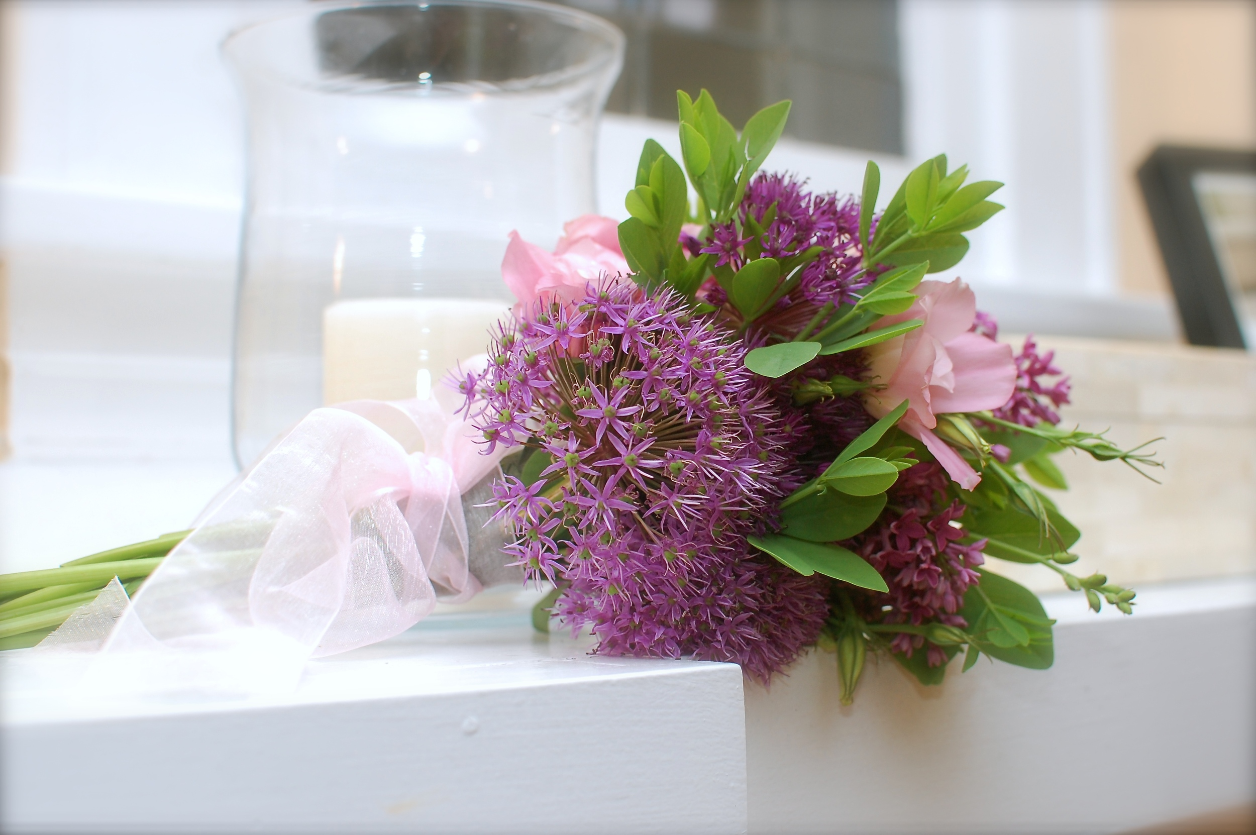 Delicate bouquet of allium, baptisia, lisianthus, and lilac.