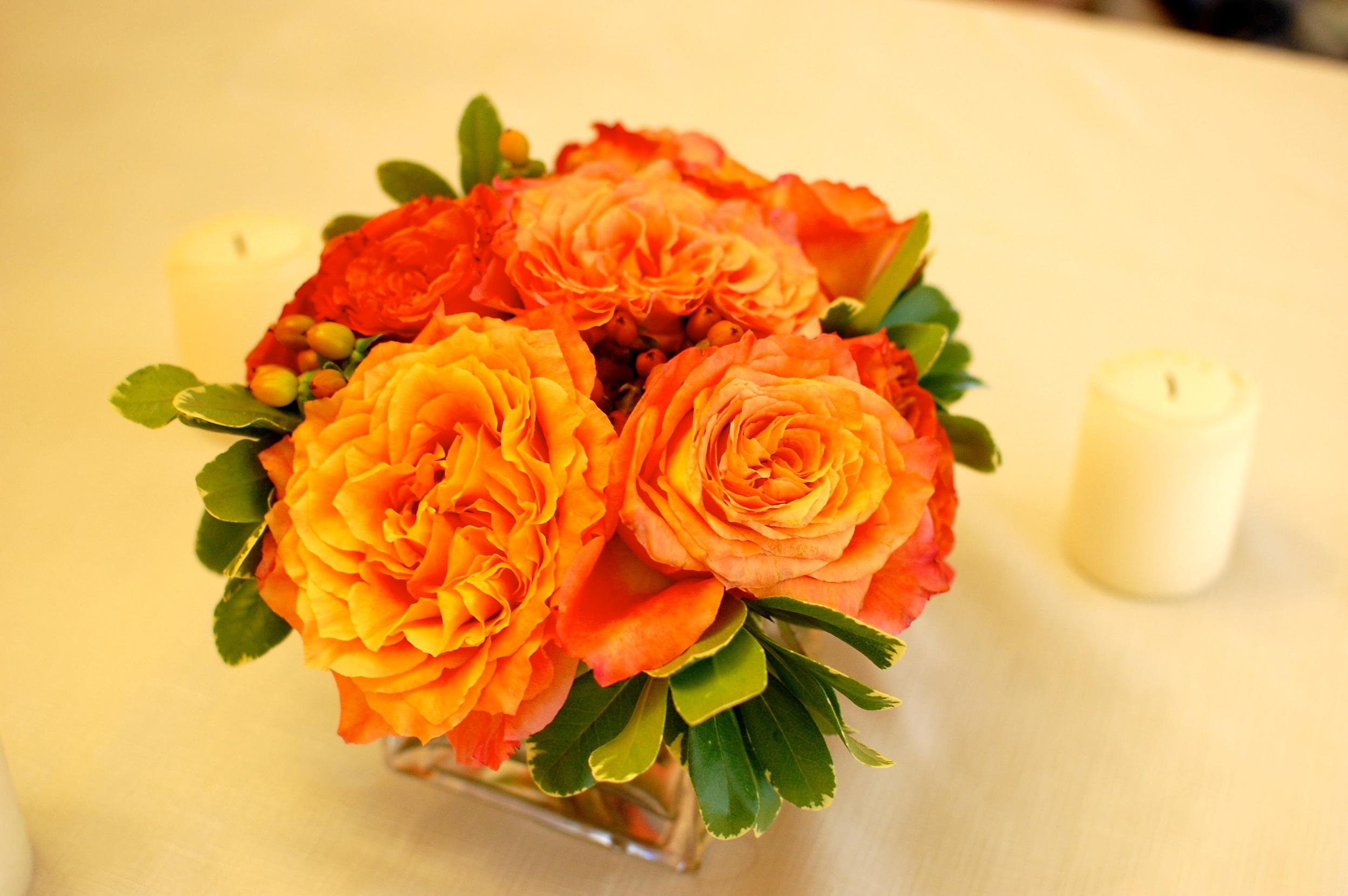 A beautiful fall arrangement of garden roses, hypericum berries and greenery.