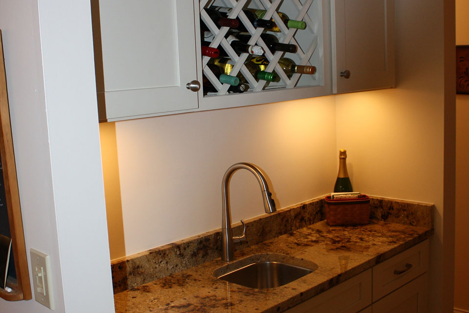 Bar Area with Sink and Cabinets