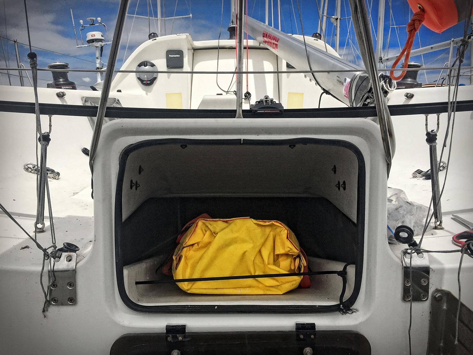 Winslow 4-man ultralight life raft in the escape hatch