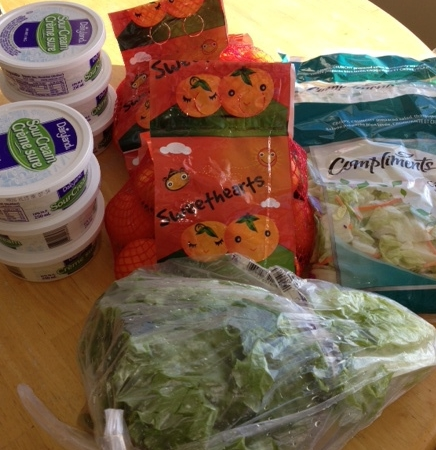 Green Leaf Lettuce $1.00  Compliments bagged salad $1.00  Dairyland Sour Cream $1 - used $2 off 3 coupon  Mandarin oranges $1.49   Paid $7.48    Saved $22