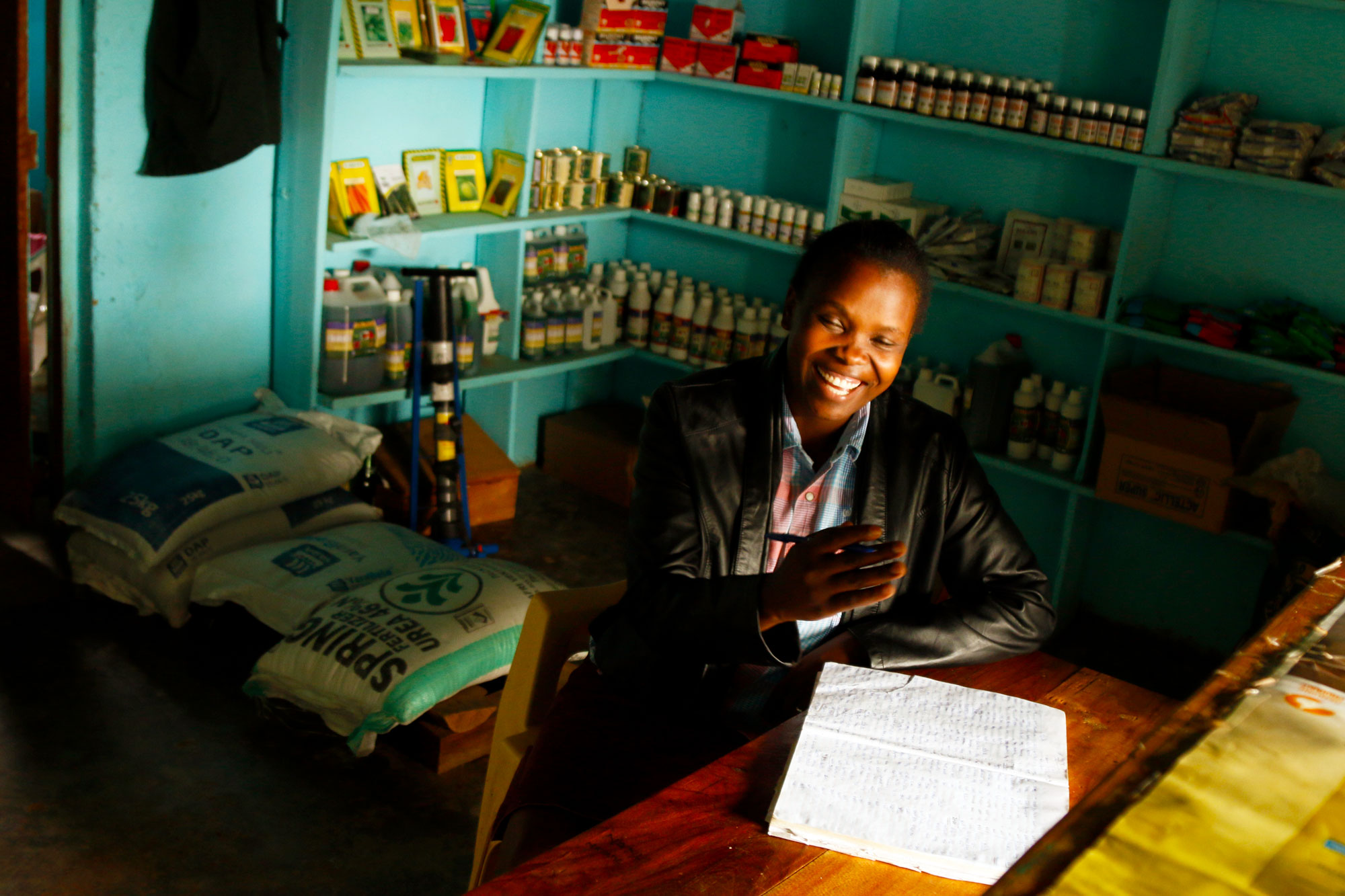 Maureen Simiyu runs a farm supply shop in Bungoma, Kenya. Because many small-scale farmers struggle to afford basic supplies, business is often slow. When drought hits, it can drop by half.   (Tim McDonnell)