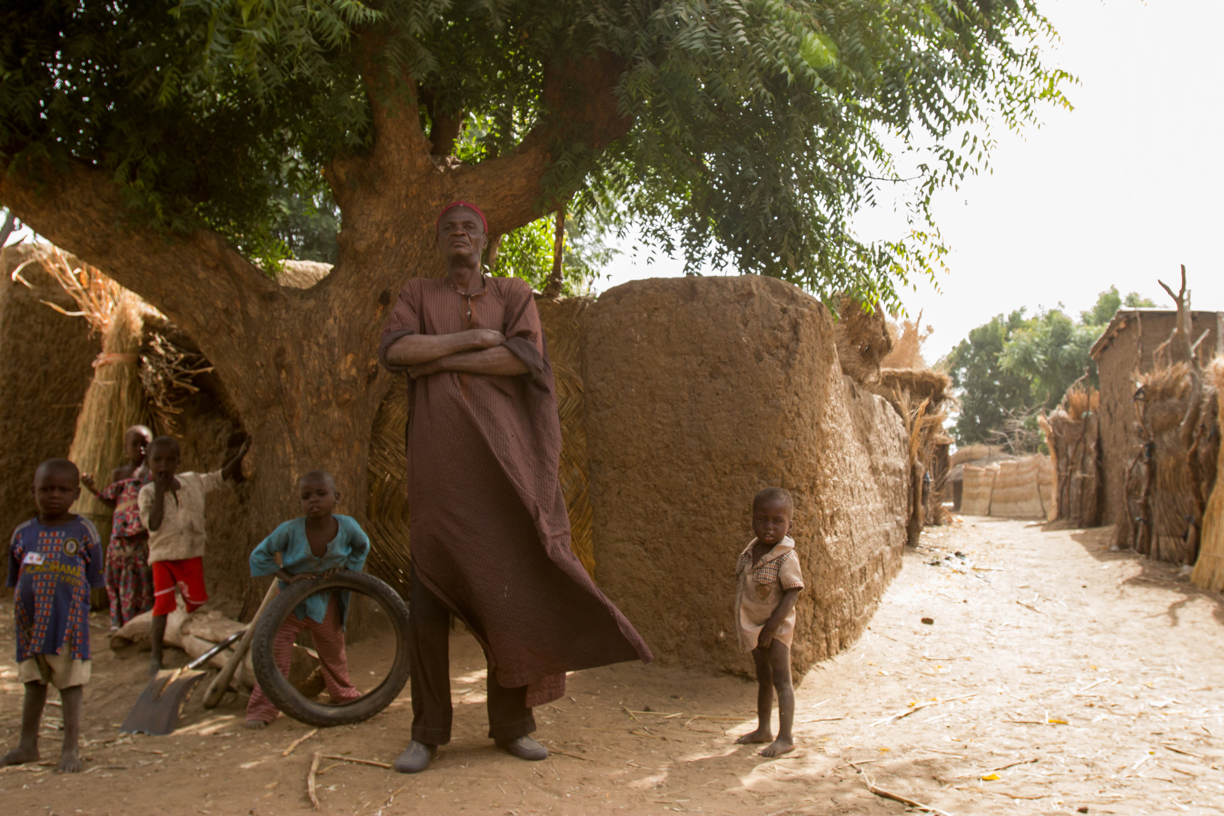 """Things now are changing. It might become very difficult to stay here if things don't improve,"" says Maigari Lawal, the chief of Saidagyada village in northern Nigeria. ""But God wants us to live here. It's only God who can decide."" (Tim McDonnell)"