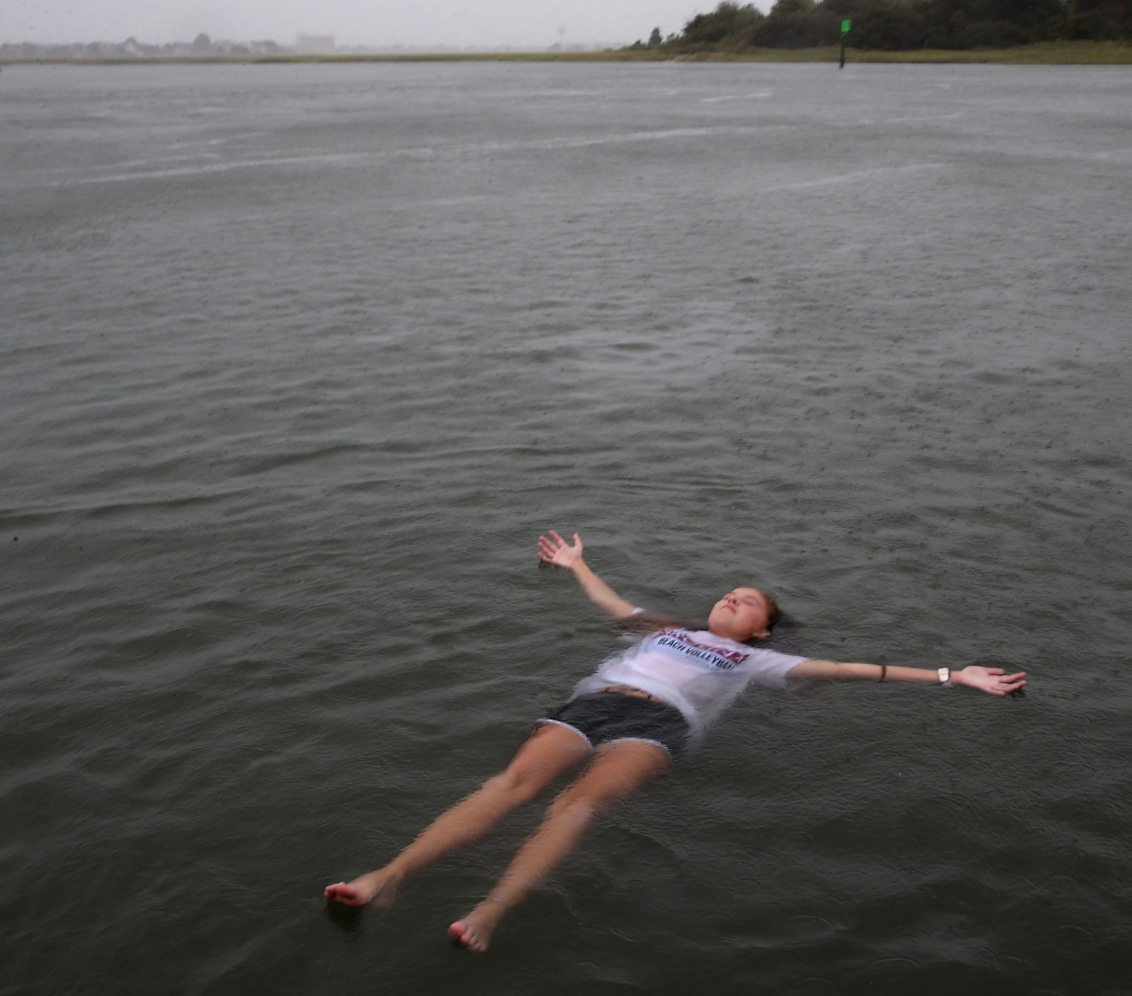 WILMINGTON, NC—September 13, 2018: Elizabeth Claire Toomer floats while swimming with friends in the Intracoastal Waterway as Hurricane Florence approached the area. Photo by Mark Wilson/Getty Images News/Getty