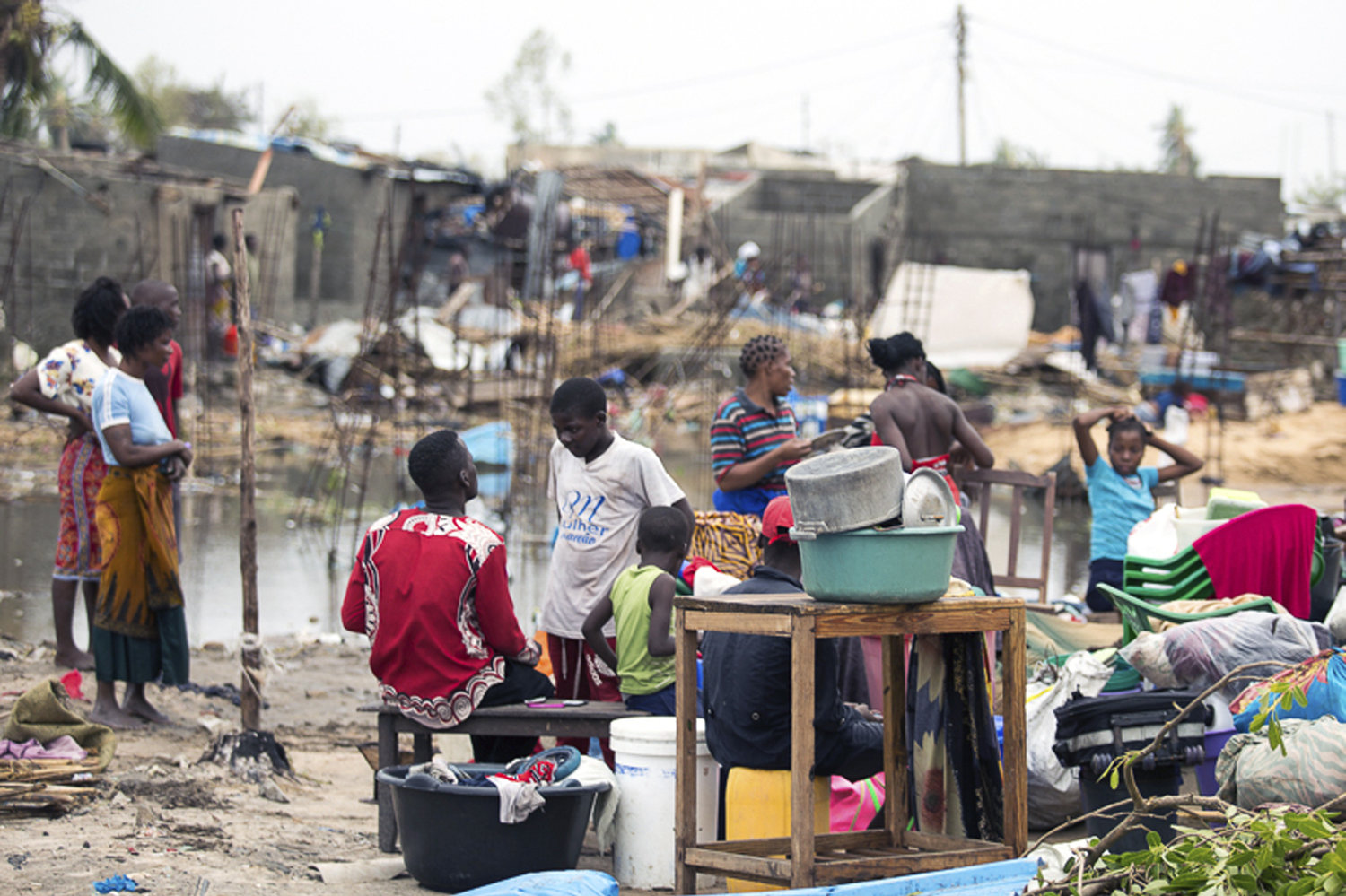 Residents of the city of Beira, which was nearly destroyed by Cyclone Idai, salvage what is left of their belongings.   Denis Onyodi/International Red Cross via AP