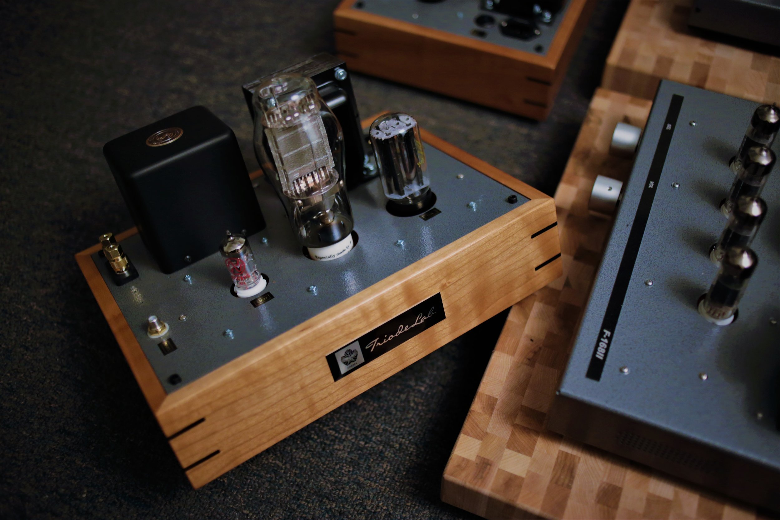 Unit upgraded with custom maple wood frame by Coherent Loudspeakers.