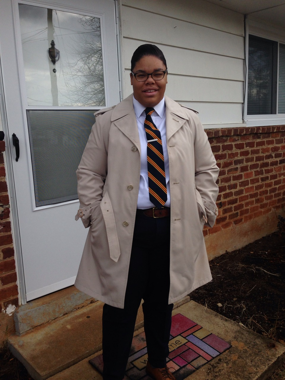 Both trench and tie are thrifted