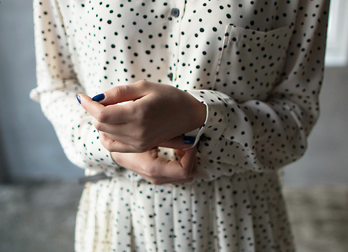 A slick cobalt mani tops off a classic black and white look. | From  Tarot Cards and Toasters