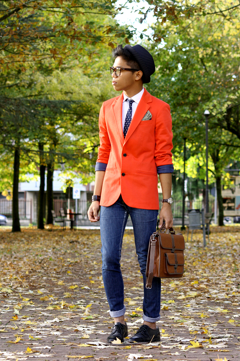 This orange blazer really pops. I also love the pattern mixing between the polka dot tie, paisley pocket square, and striped hat. | From:  thechicstyler.com