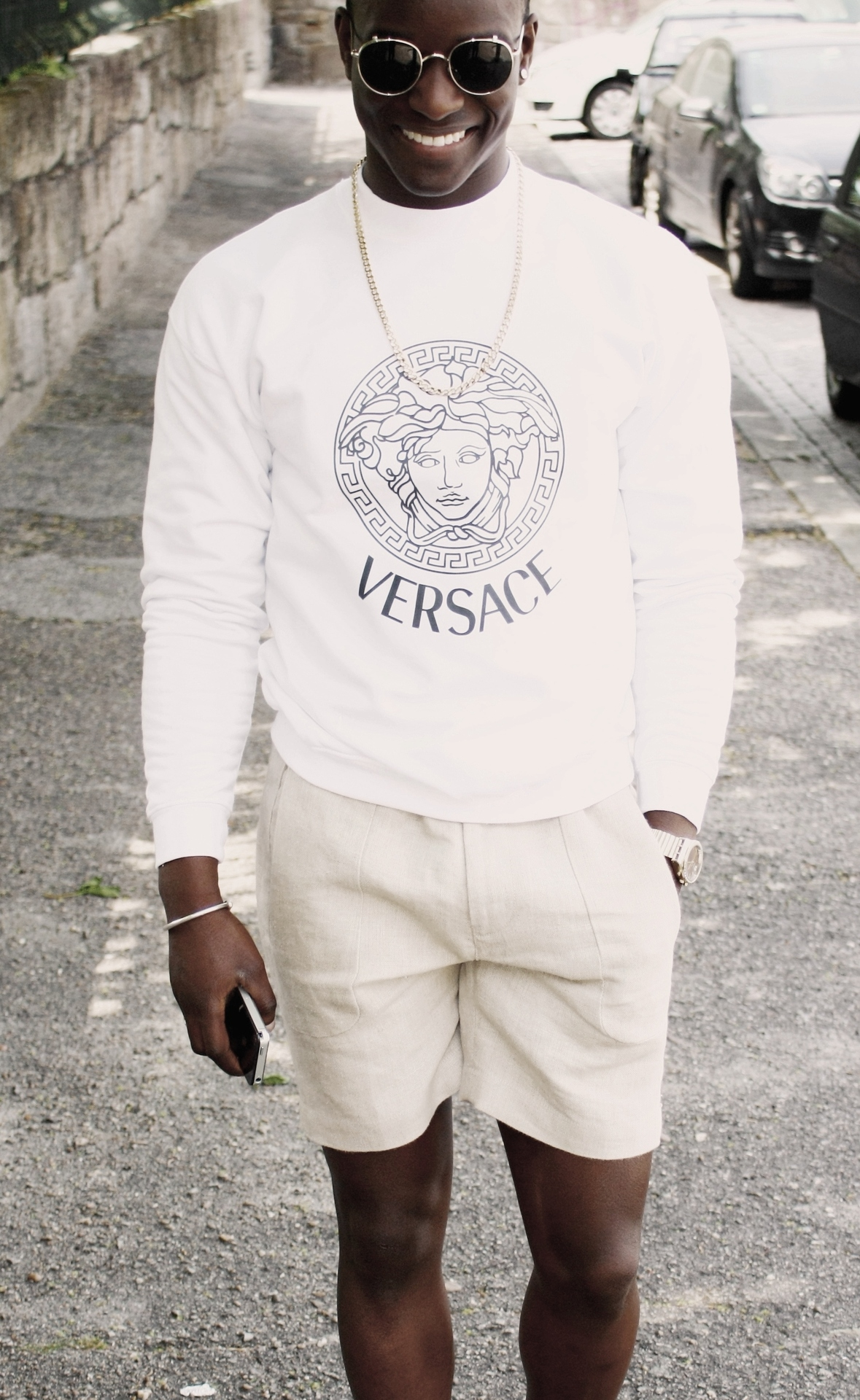 While we're talking about all white, I love the unlikely combinations of the Versace sweatshirt with the bling. I'll take what he's wearing! From:  blackfashion.tumblr.com