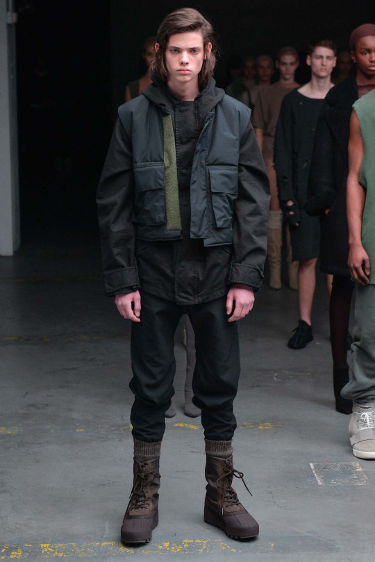 I love the mixture of browns, blacks,navy, and green. The palette is beautiful, and because they're wearing a vest over another jacket, it creates a cool shape. I feel like they are going to go fight in a post-apocalypticwar... or maybe it's just winter. From: Kanye West x Adidas Originals Fall2015