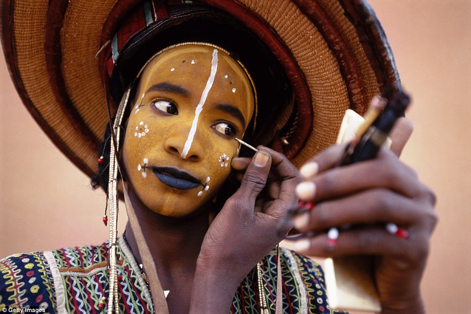 A person in the Wodaabe tribe applying make up