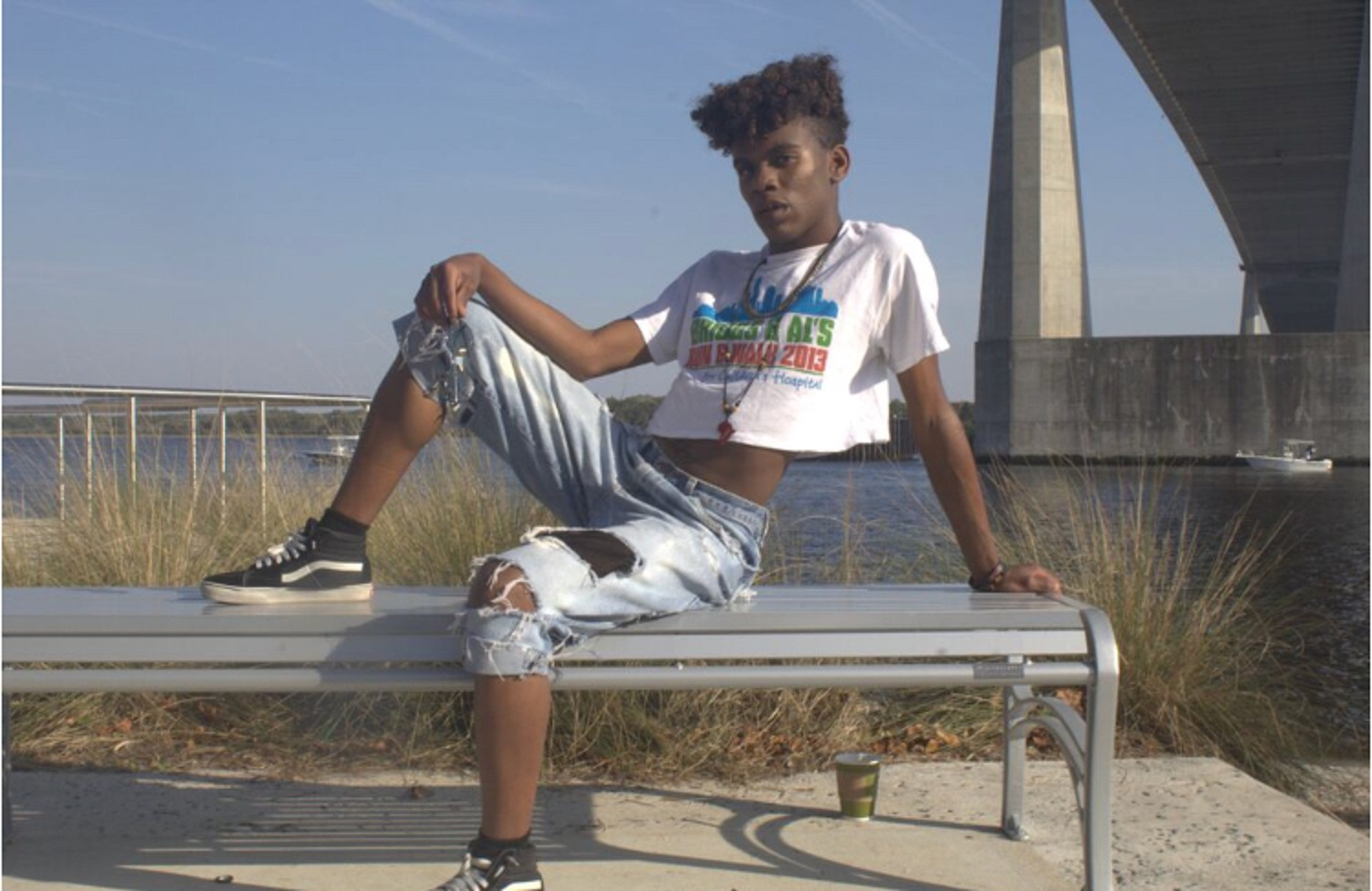 Graphic Summer - Delucollect Top / Levi's Pants (He did the distressing details himself) / American Eagle Flannel / Nike's Huarache Sneakers / Name Plated African Yarn Necklace & Bracelet Handmade from Congo / Ebay Gold Cross Necklace / Walmart Black Ankle Socks