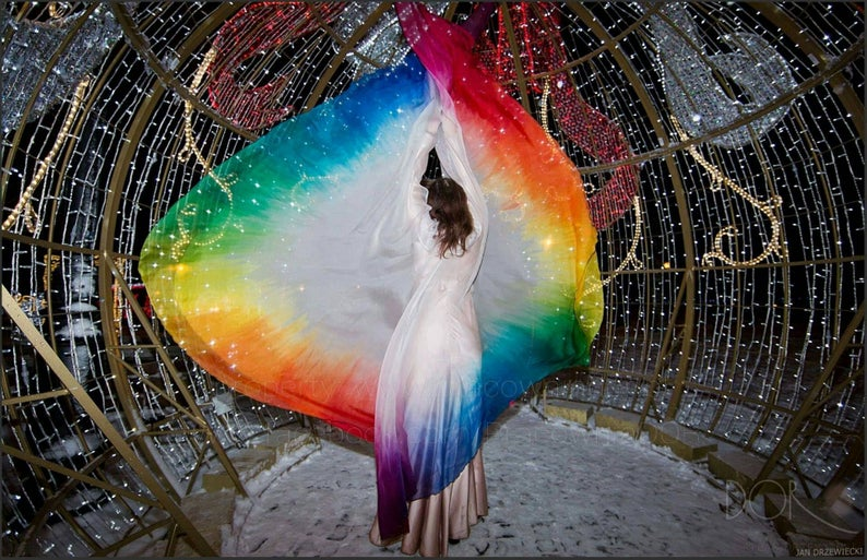 Rainbow transparent cape made of two full circles of silk organza.