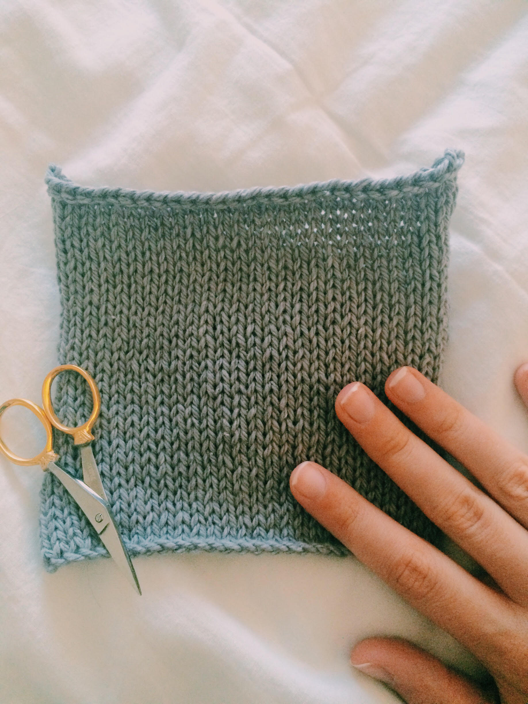 the initial swatch in O-Wool, knit in the round.
