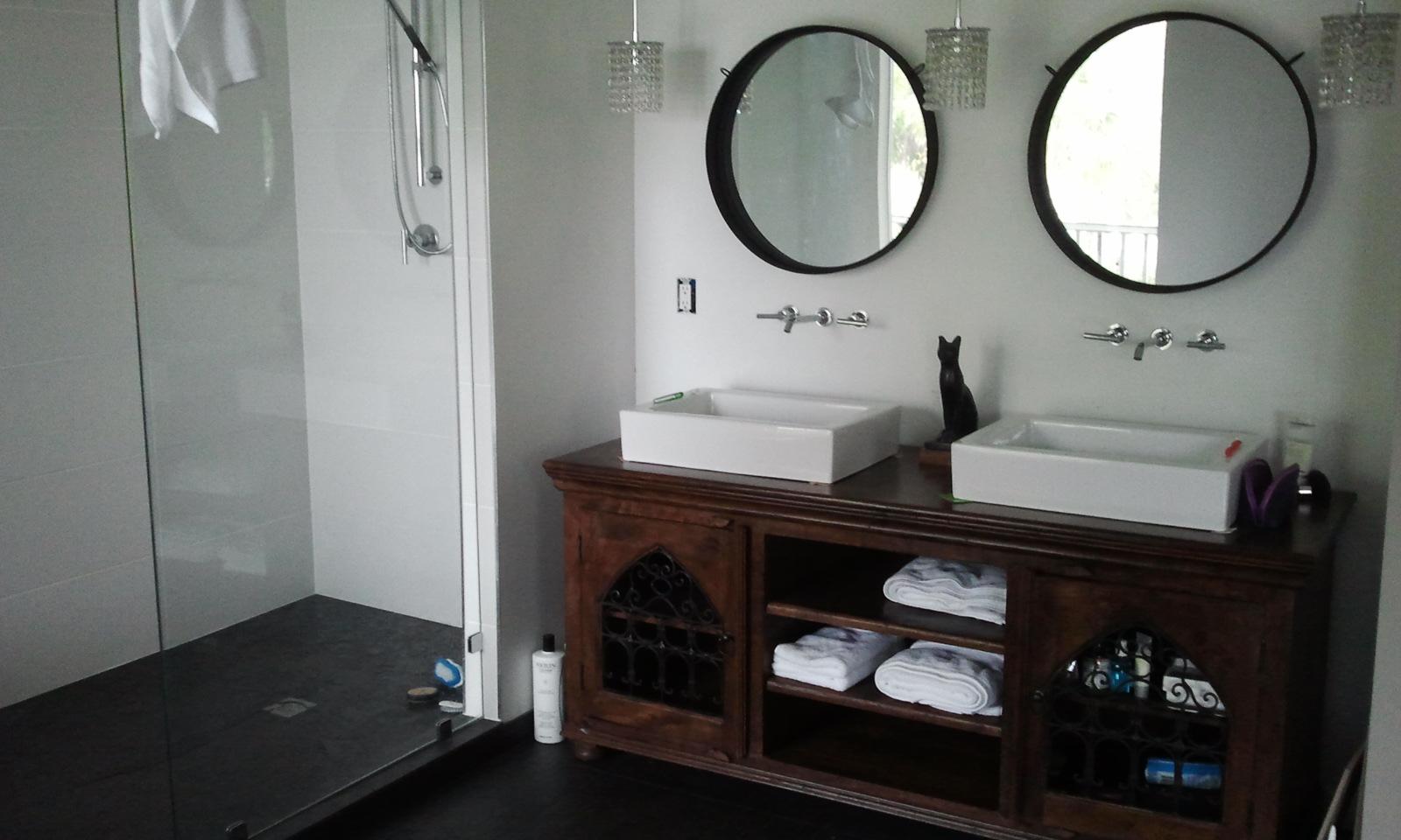 Indian rosewood media stand being used as a bathroom vanity...
