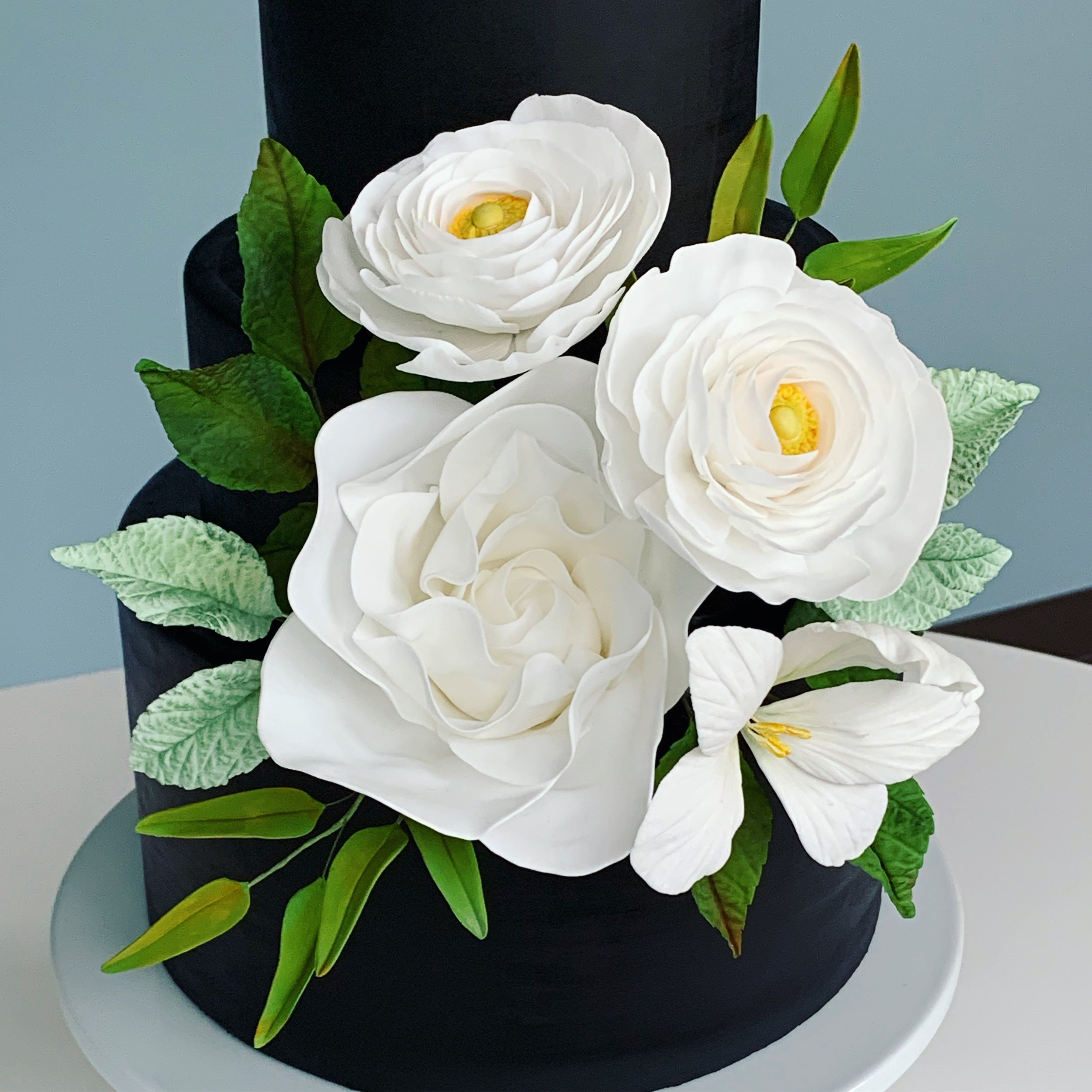 Sugar ranunculus, bauhinia, and modern rose with foliage. Image copyright Carla Schier.