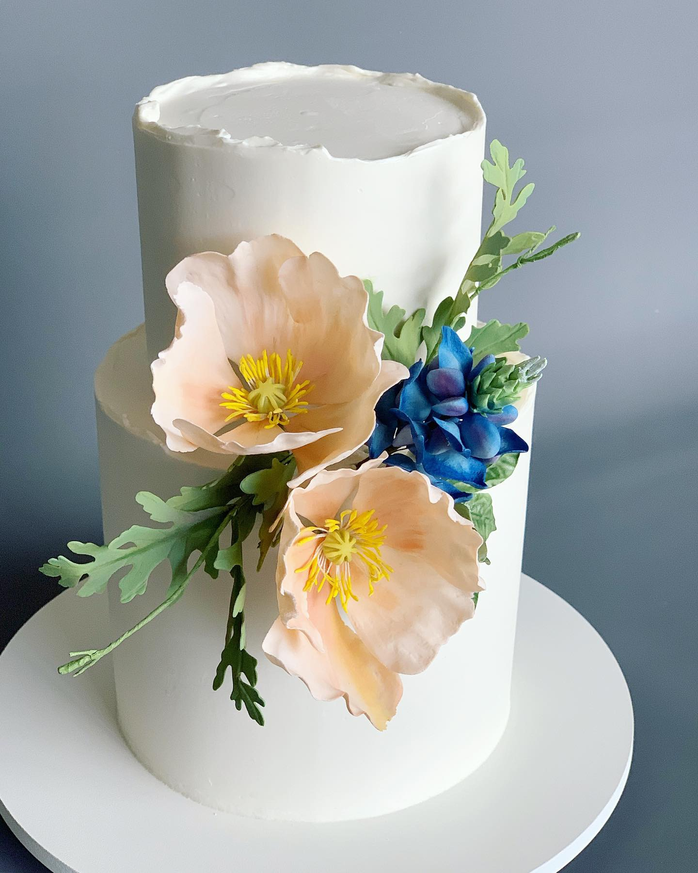 Handcrafted sugar California poppies and Texas bluebonnets. Image copyright Carla Schier.