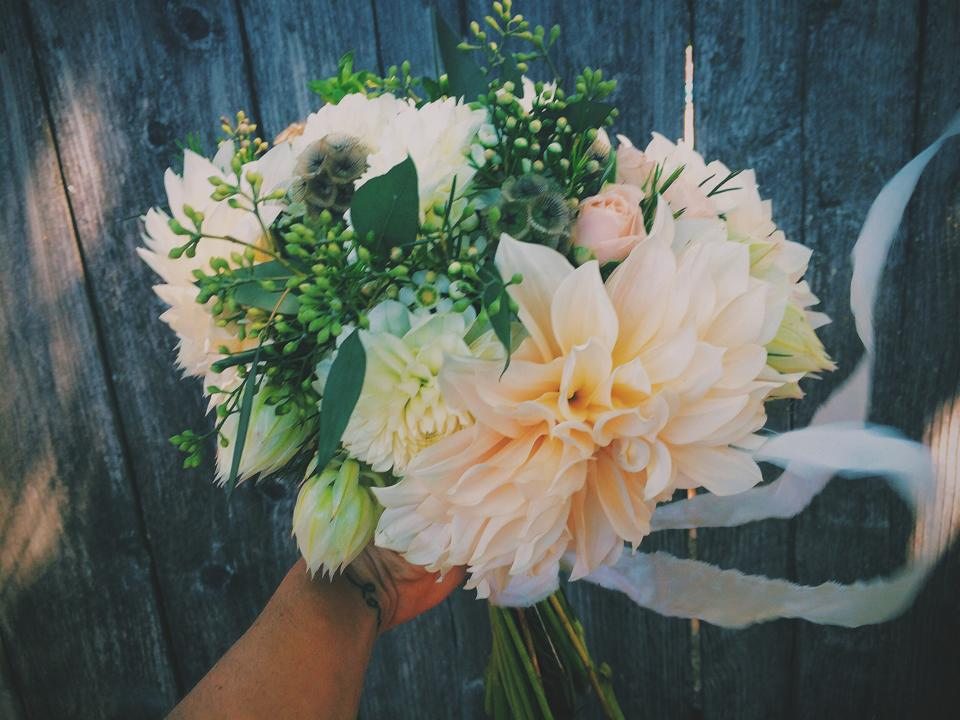 Cafe Au Lait Dahlias, Blushing Bride Protea, White Pom Pom Dahlias, Seeded Eucalyptus, Stellata Pods, Spray Roses, and White Wax Flower.