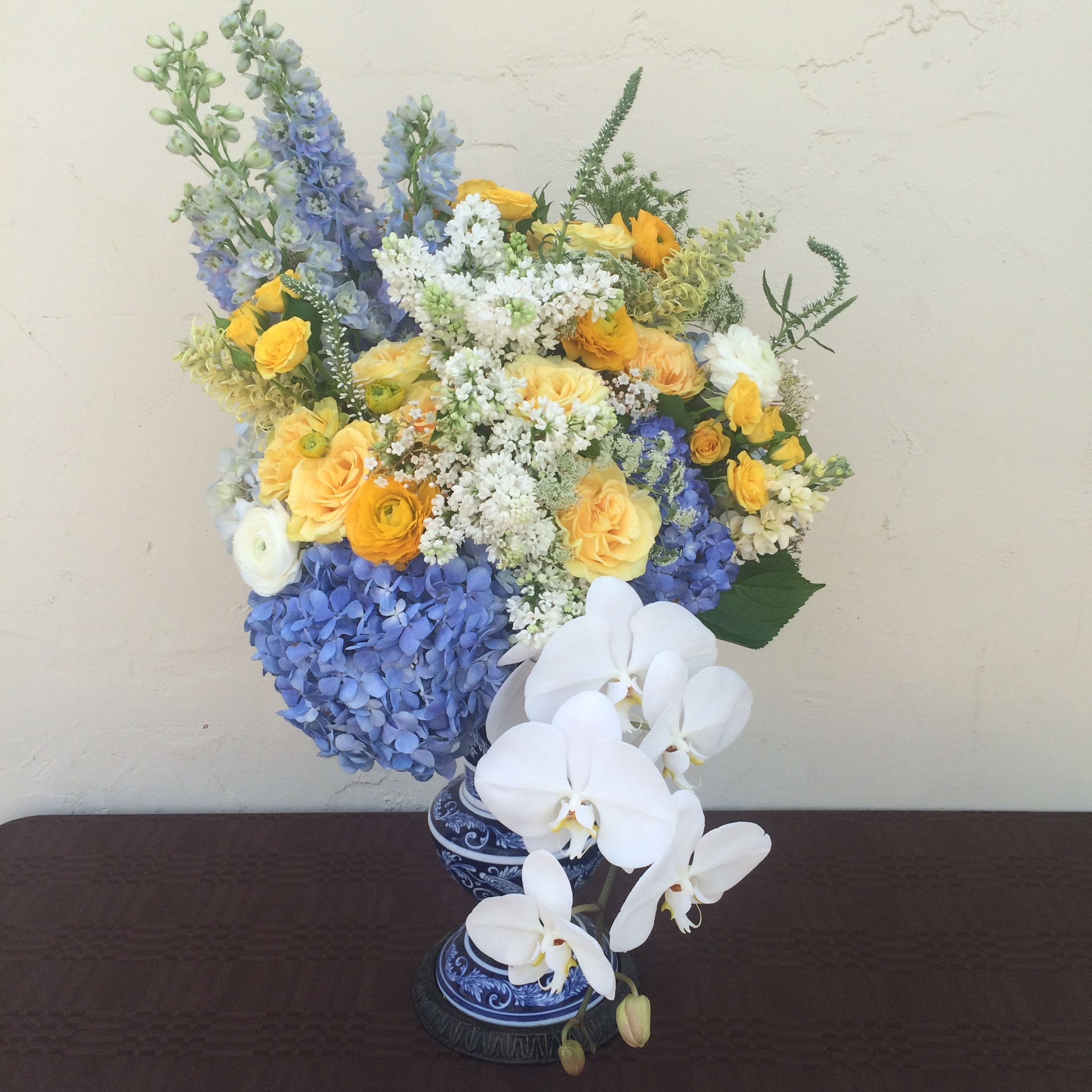 Blue, white and yellow memorial display in an antique Asian vase (the picture does no justice to the size of this hefty lady)!  Event: Wedding at Private Estate in Green Valley, CA