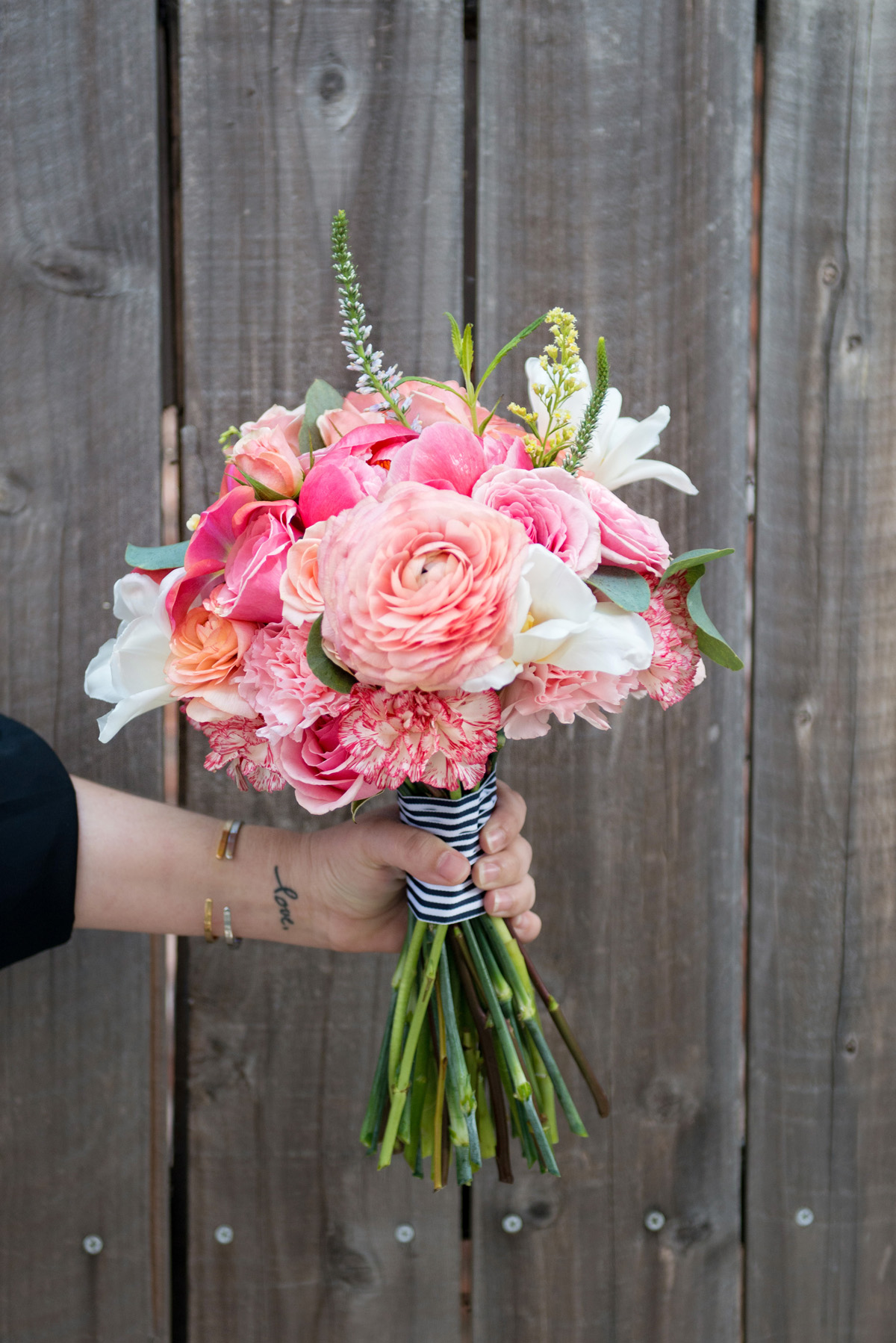 Coral pink with navy and white stripes for this bridesmaid bouquet for a Park Winters Wedding.  Event: Wedding, Park Winters, Winters, CA (photo courtesy of Crystal Lynn Photography).