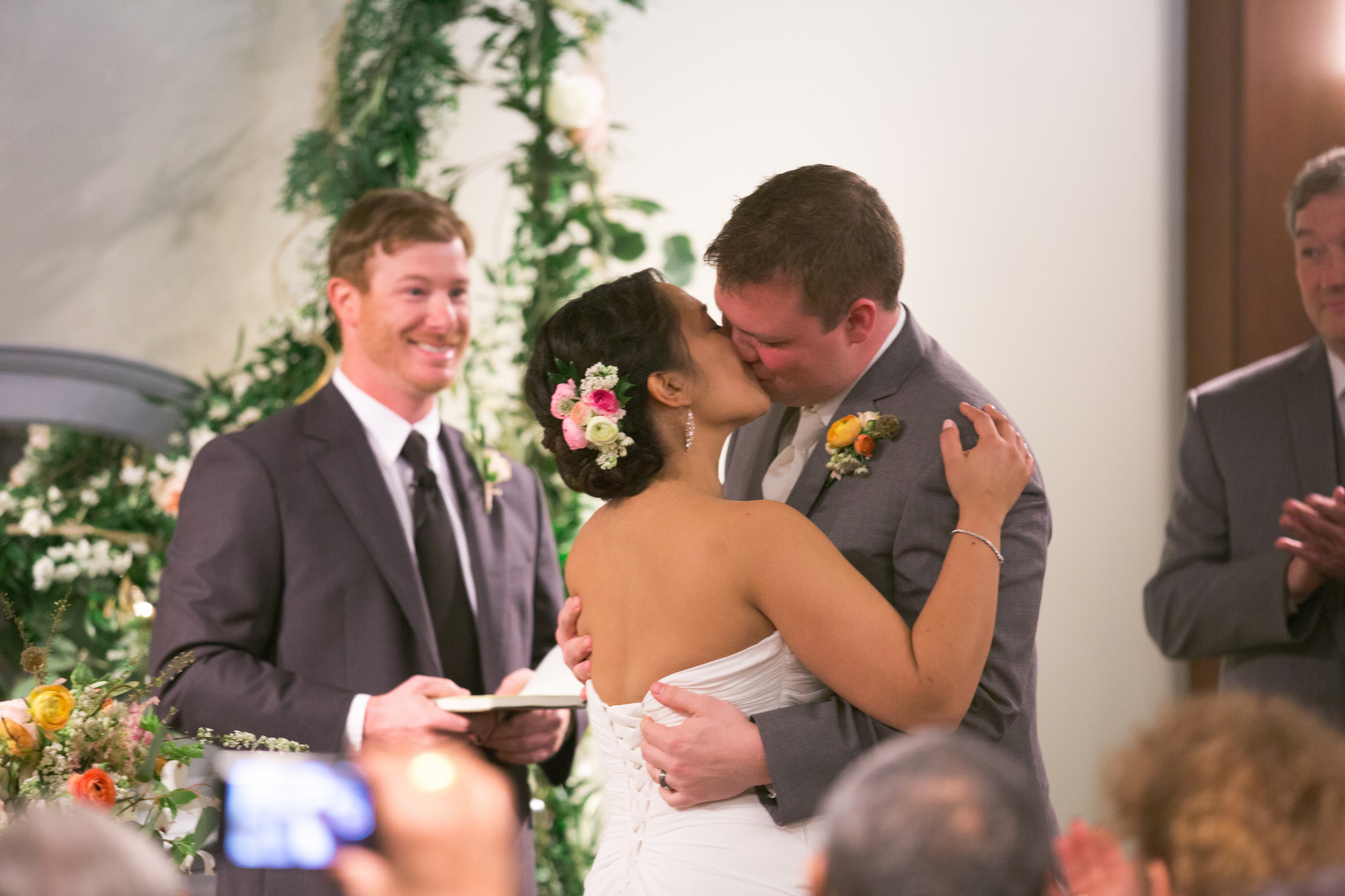 the couple's best friend, Alan, officiated the nuptials in this photo