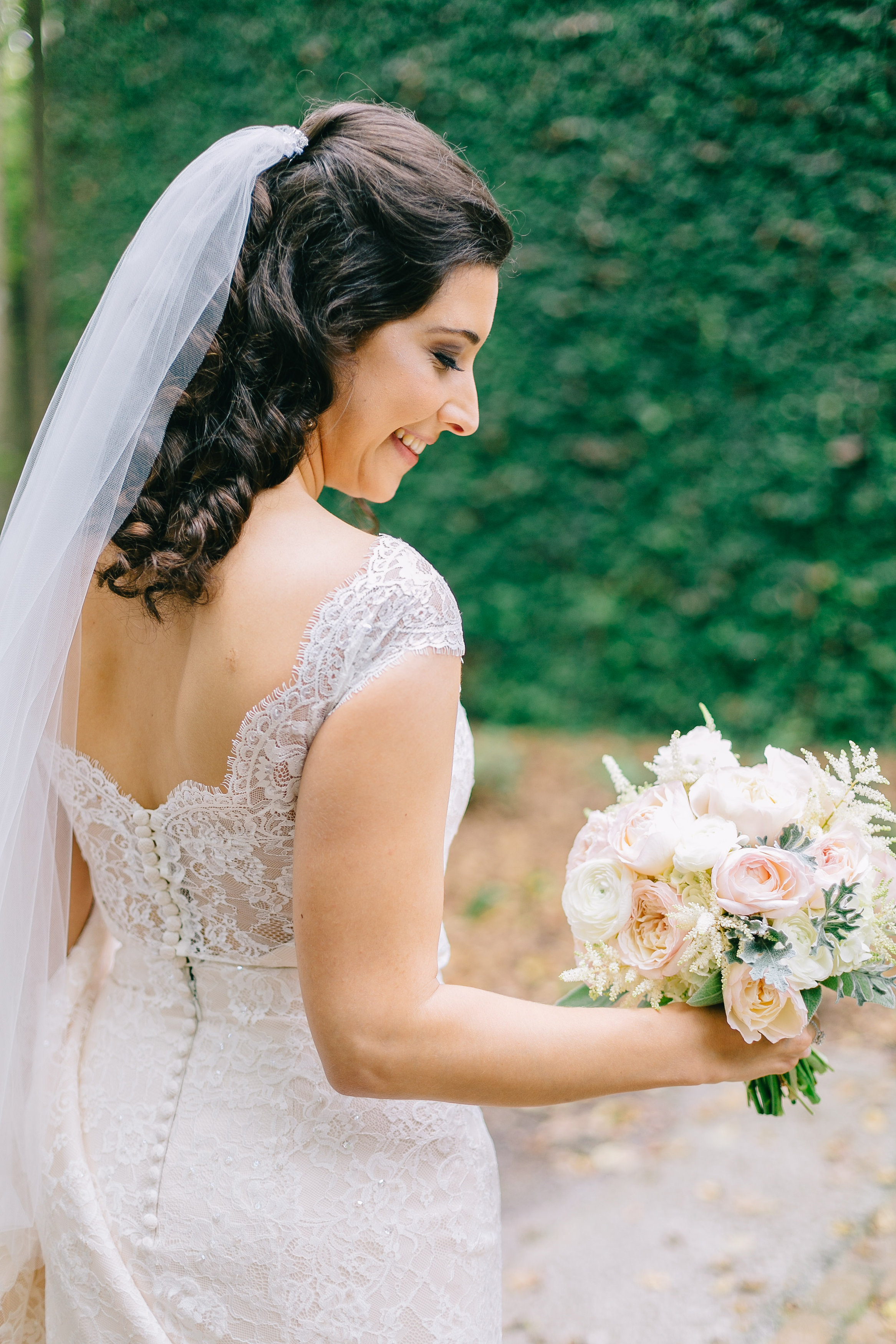 middleton place charleston wedding planners | bridal bouquet in blush pink and ivory tones with blush pink and white David Austen garden roses, white ranunculus, lambs ear, white astilbe, and white hydrangea