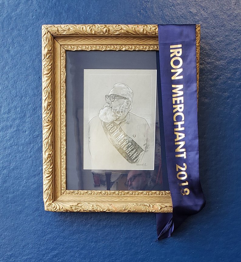 Frame portrait of Chuck in his highly coveted sash.