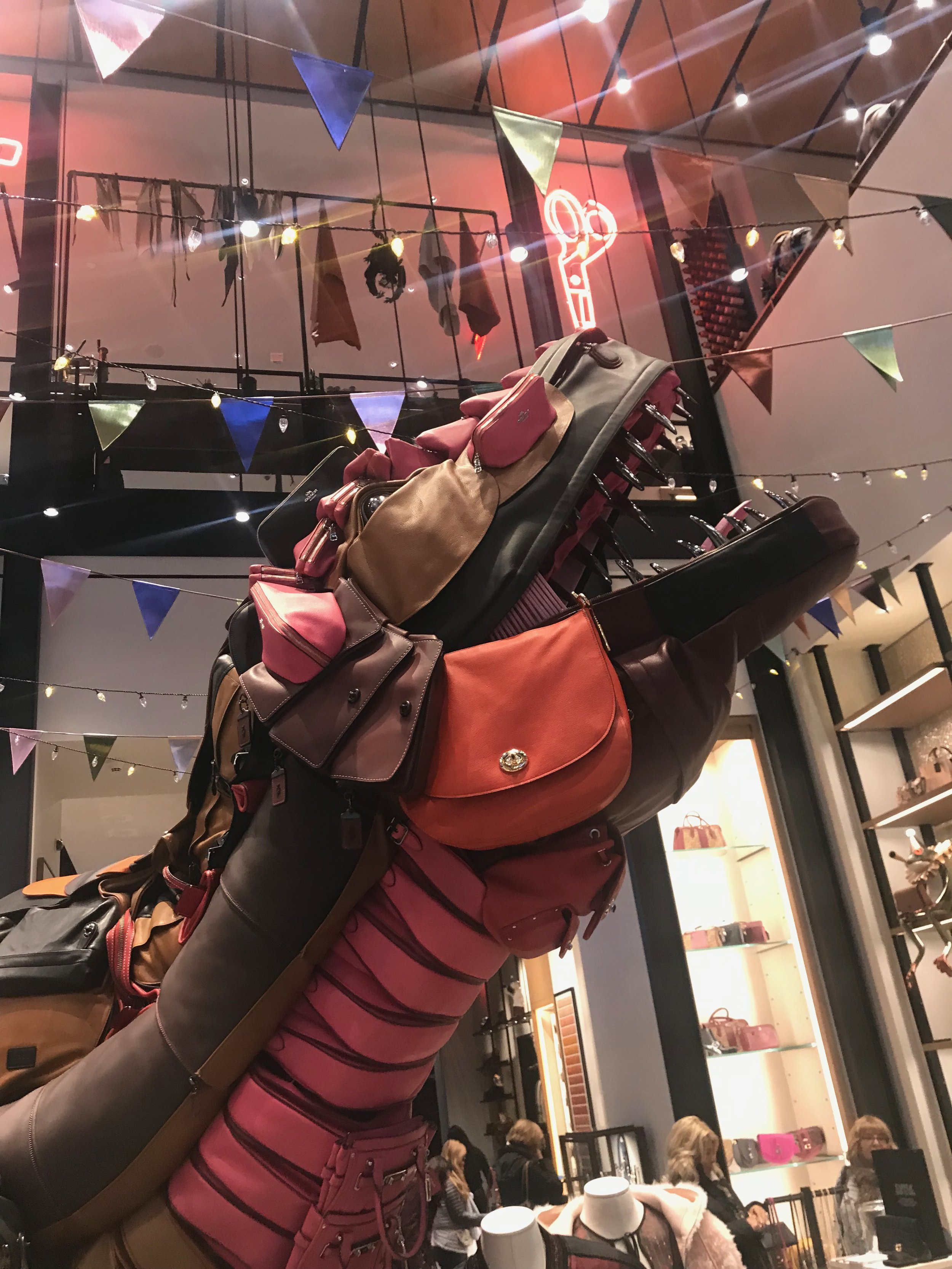 A conveyer belt, in-house workshop and 12-foot dinosaur, Rexy, surprises and delights visitors at COACH'S Fifth Avenue flagship.