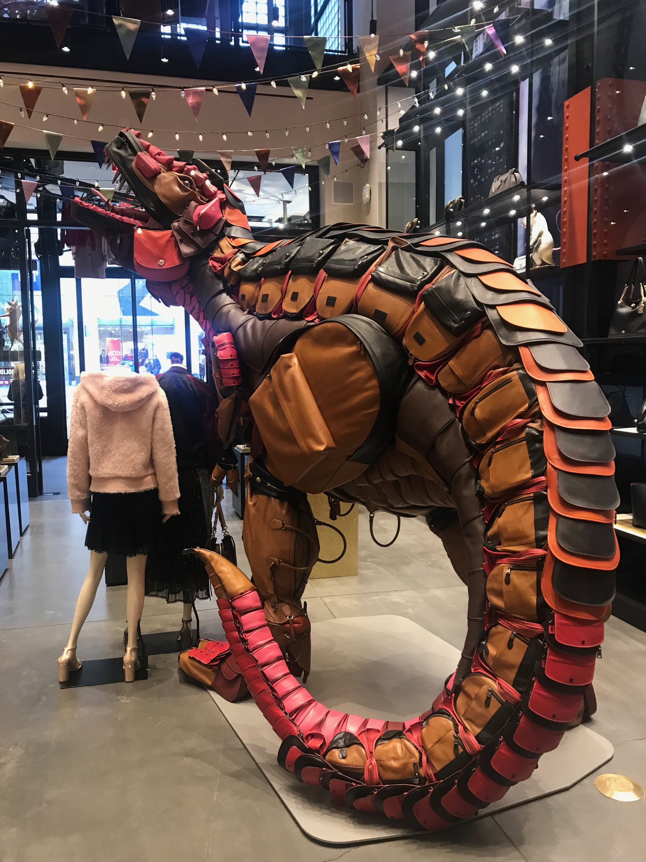 Made from 400 Coach bags, Rexy took 3 months to build - woven from a steel armature, fiberglass internal structure and stitched bag components.