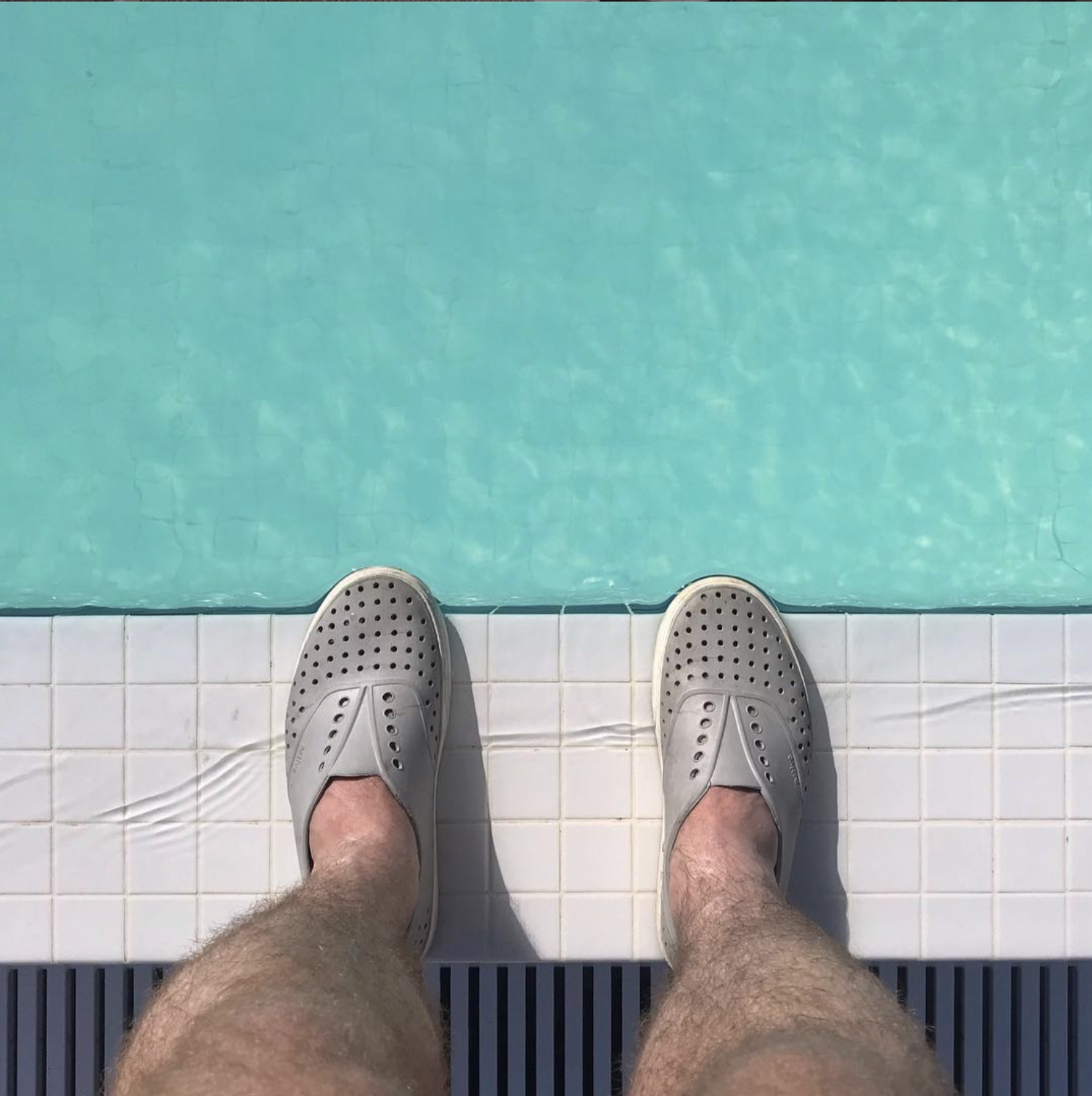 """""""I'm in Miami, Florida. They have a pool here. On the roof. Here's a pic of my shoes to prove it."""""""