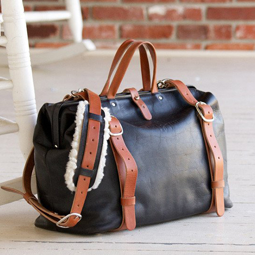 Roamographer - An American Bison Leather Camera Bag - Perfect for that traveling photographer. It has a removable divider insert to convert this weekender from a camera bag to a regular bag. If you love leather, and love a duffel type bag, this one is definitely for you. Available in Brown and Black.