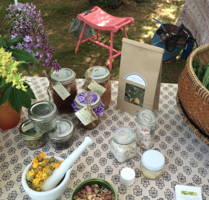 Dried herbs, flowers, canned goods, herbal remedy kit, salts, foraged greens and holistic tarot.