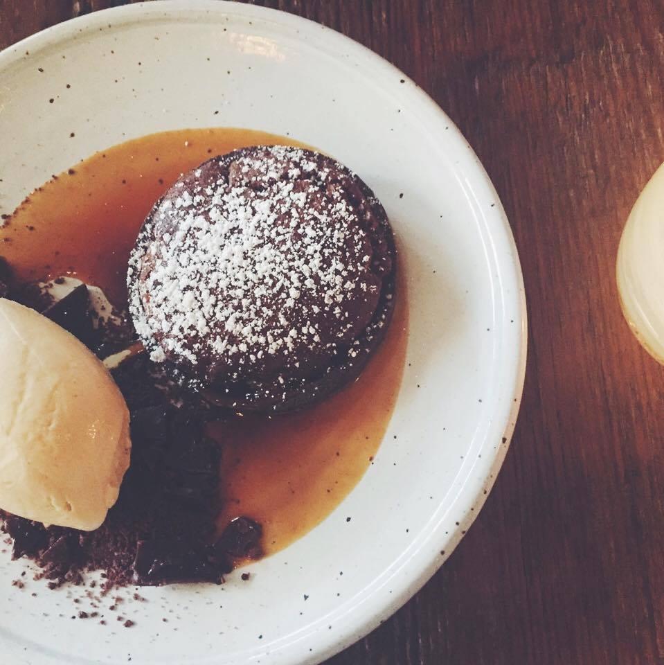 Dessert- a warm chocolate souffle tart.