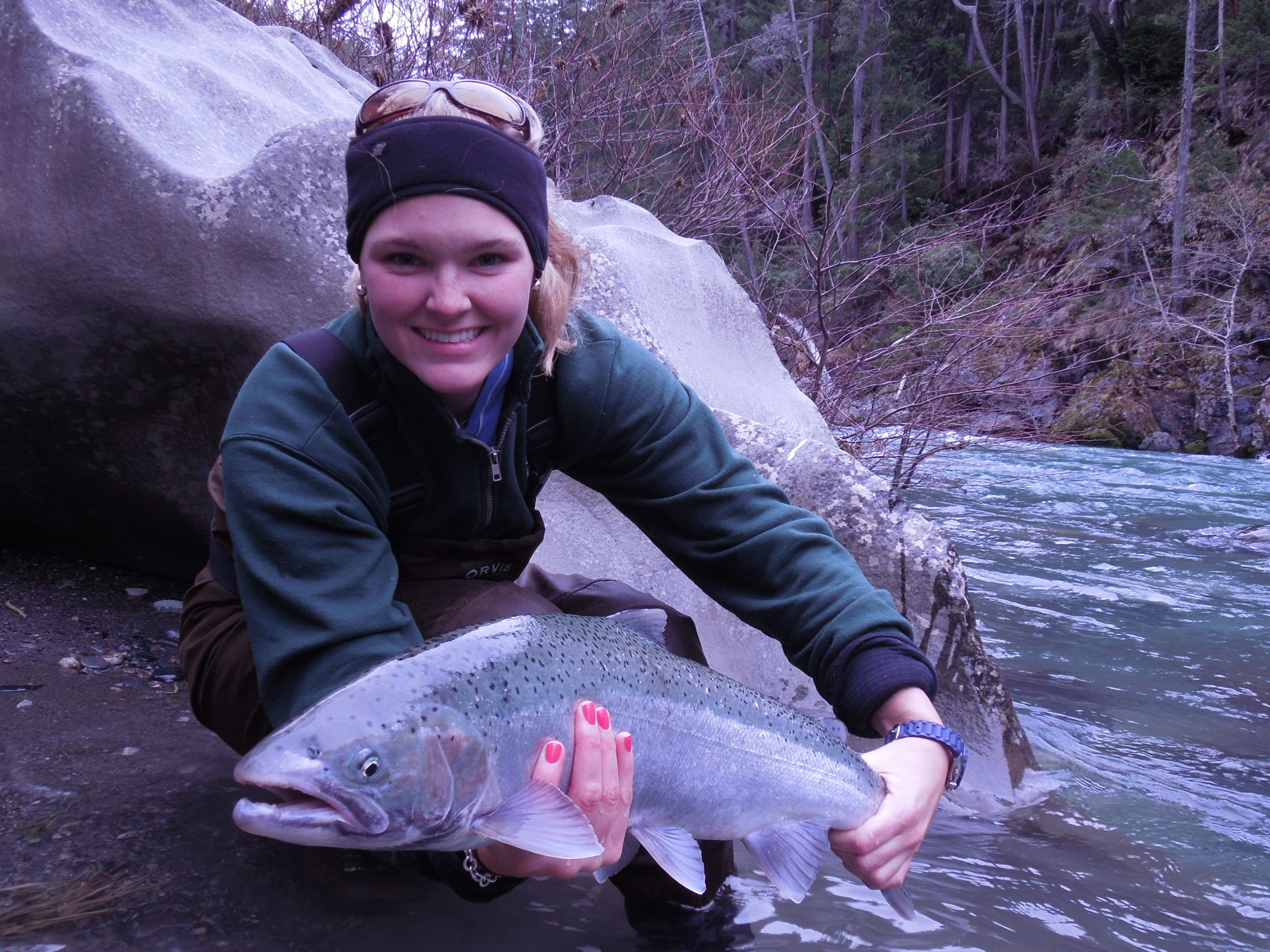Kelsey and her first steelhead, not a bad grip with hot pink polish.
