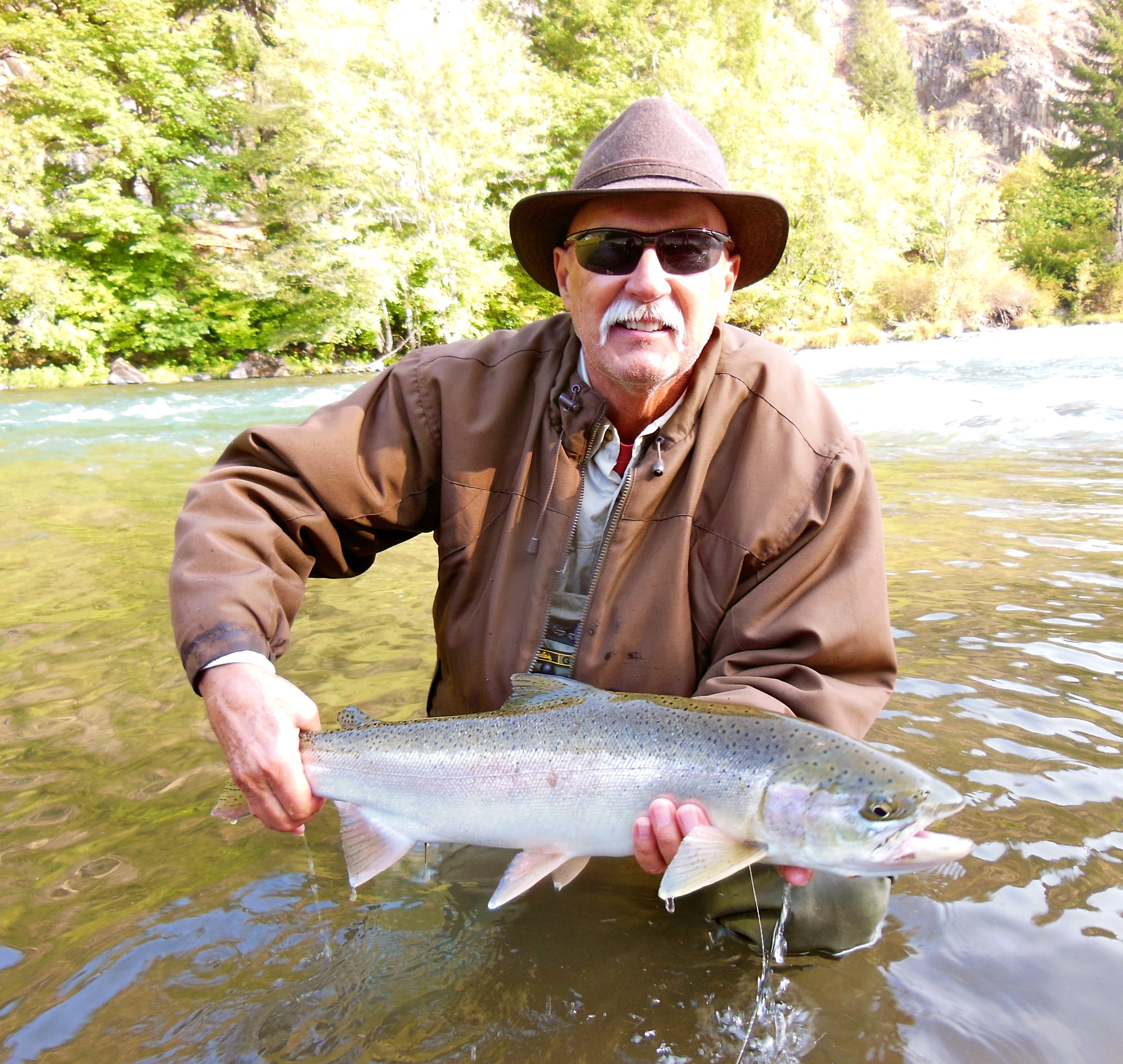 """Vincent Novits with his first North Umpqua steelhead. Vincent lost one of those epic fish the evening before, a fish that just crushed the fly and """"tore the river up""""."""