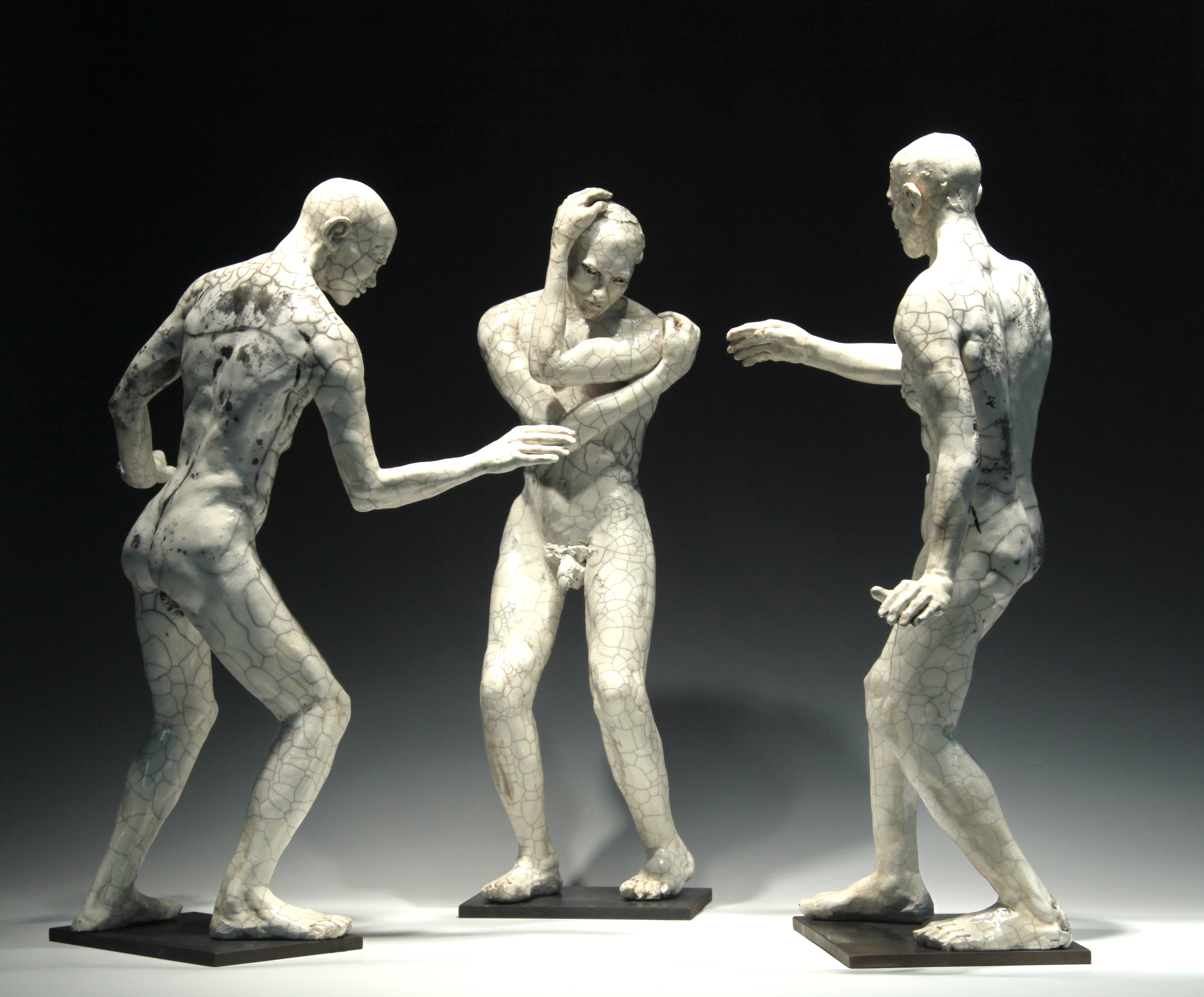 "Three Male Figures  (installation view) 23""H, raku-fired stoneware"