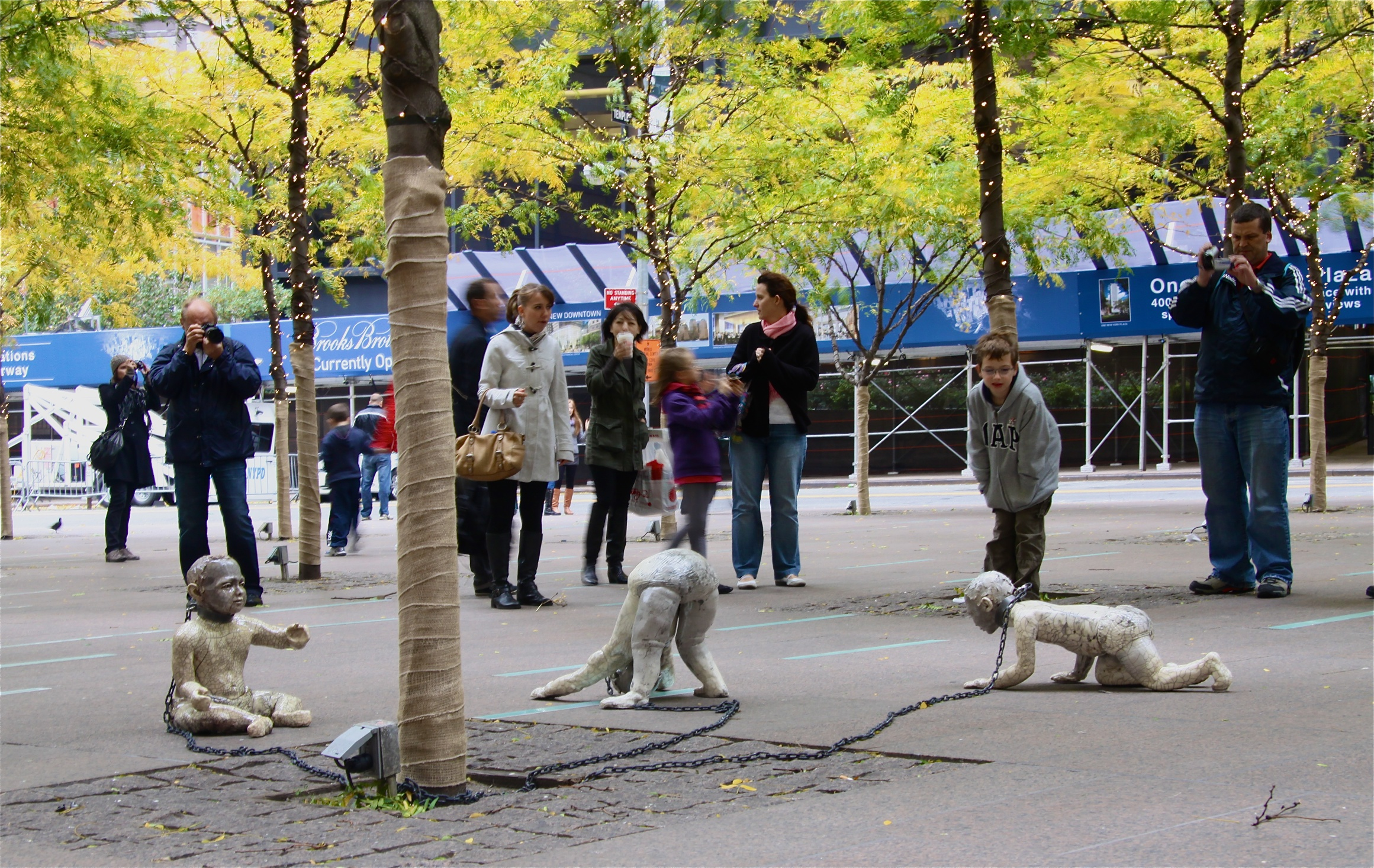 Treasury Bondage installed in Zuccotti Park in Manhattan's financial district, 2010.  Raku-fired stoneware lifesize figures, steel, chain.