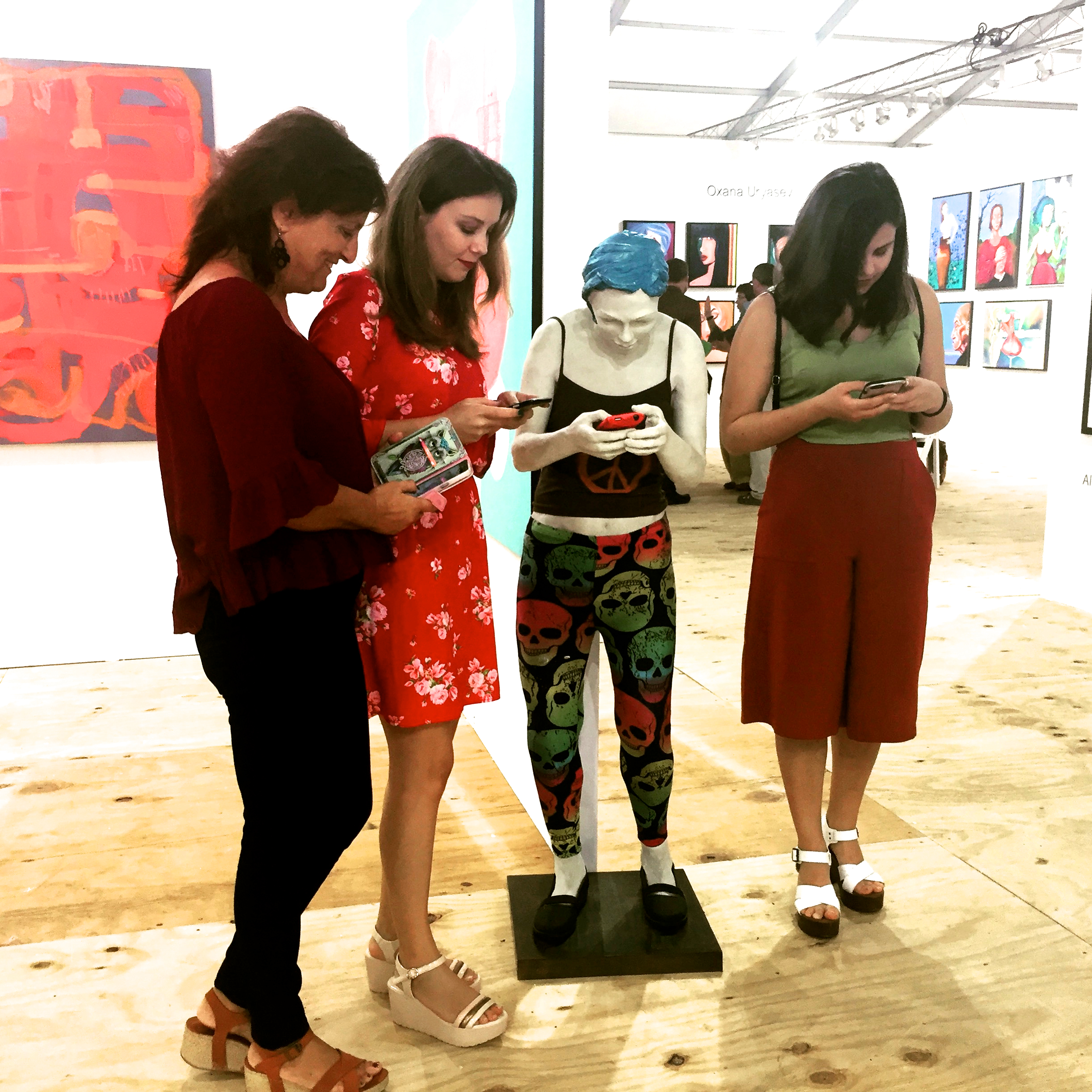 "Emily with Smartphone, 48""H standing figure, cast resin, textiles, smartphone.  Edition of 3, $12,000."