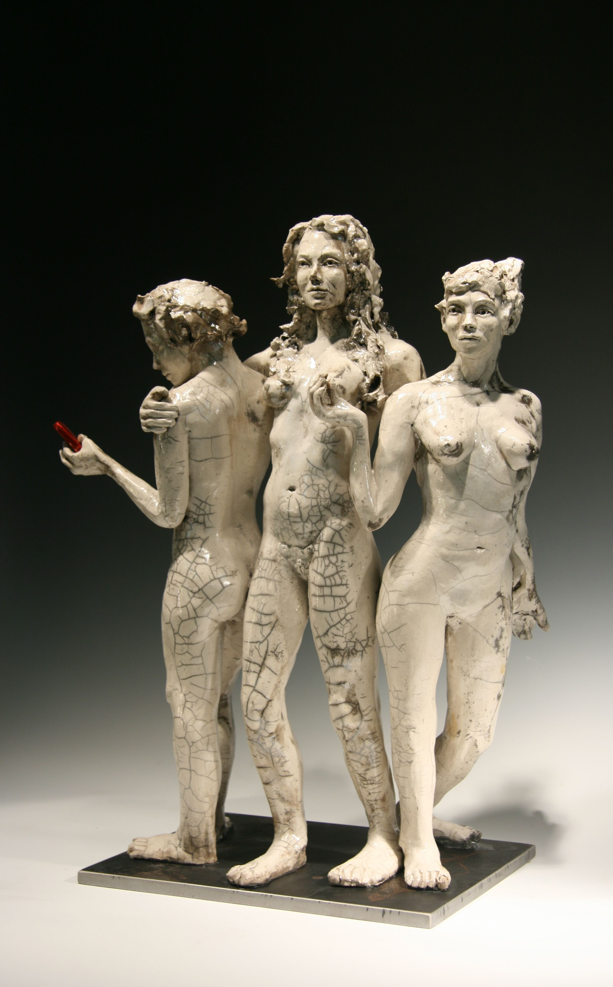 "Three Graces with Smartphone, raku fired stoneware, steel base, 3-d printed phone, 22""H, $6,000"