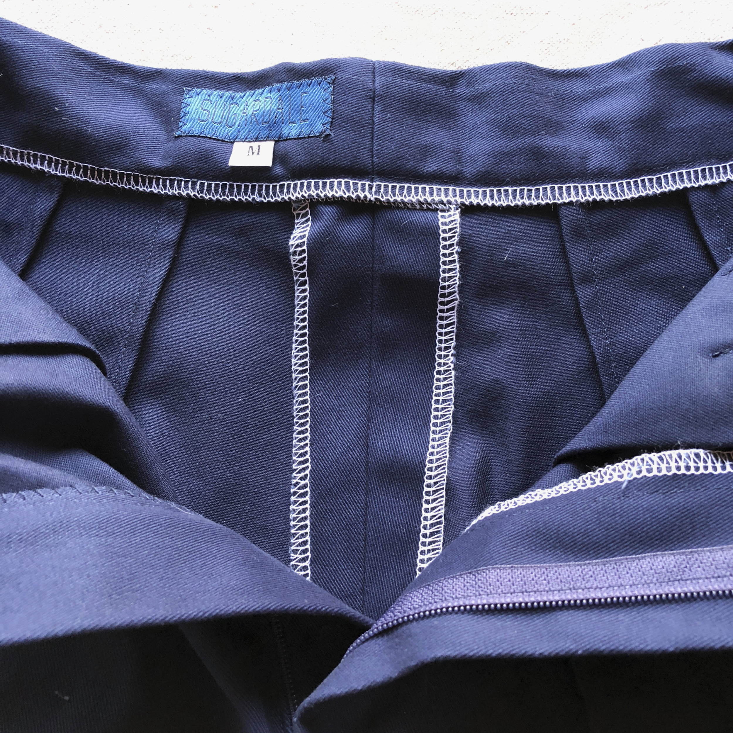 All of our garments are constructed to make alterations easy for your tailor. For example, the waistband and center back seam of the shorts are sewn together with a wide seam allowance.