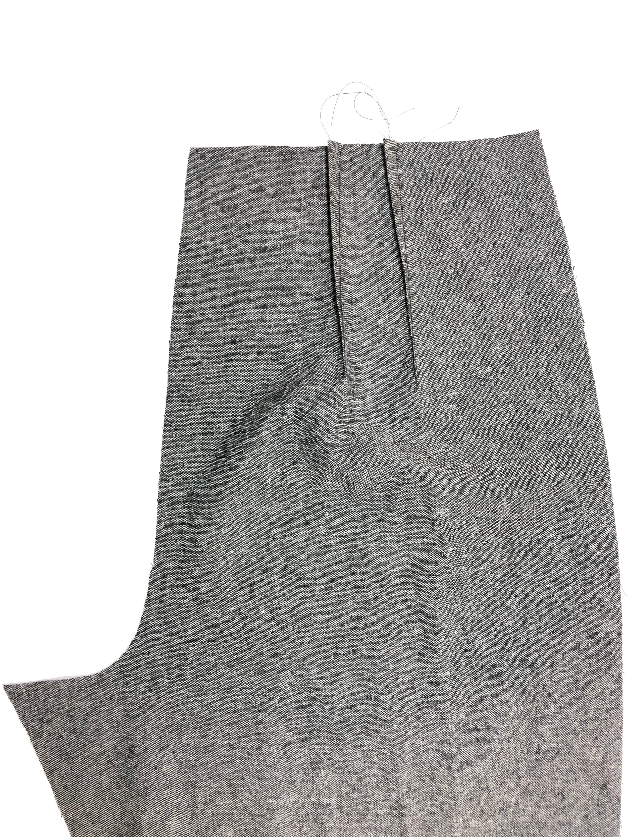5. Stitch back pant darts from notches to dot mark, and press toward center back.