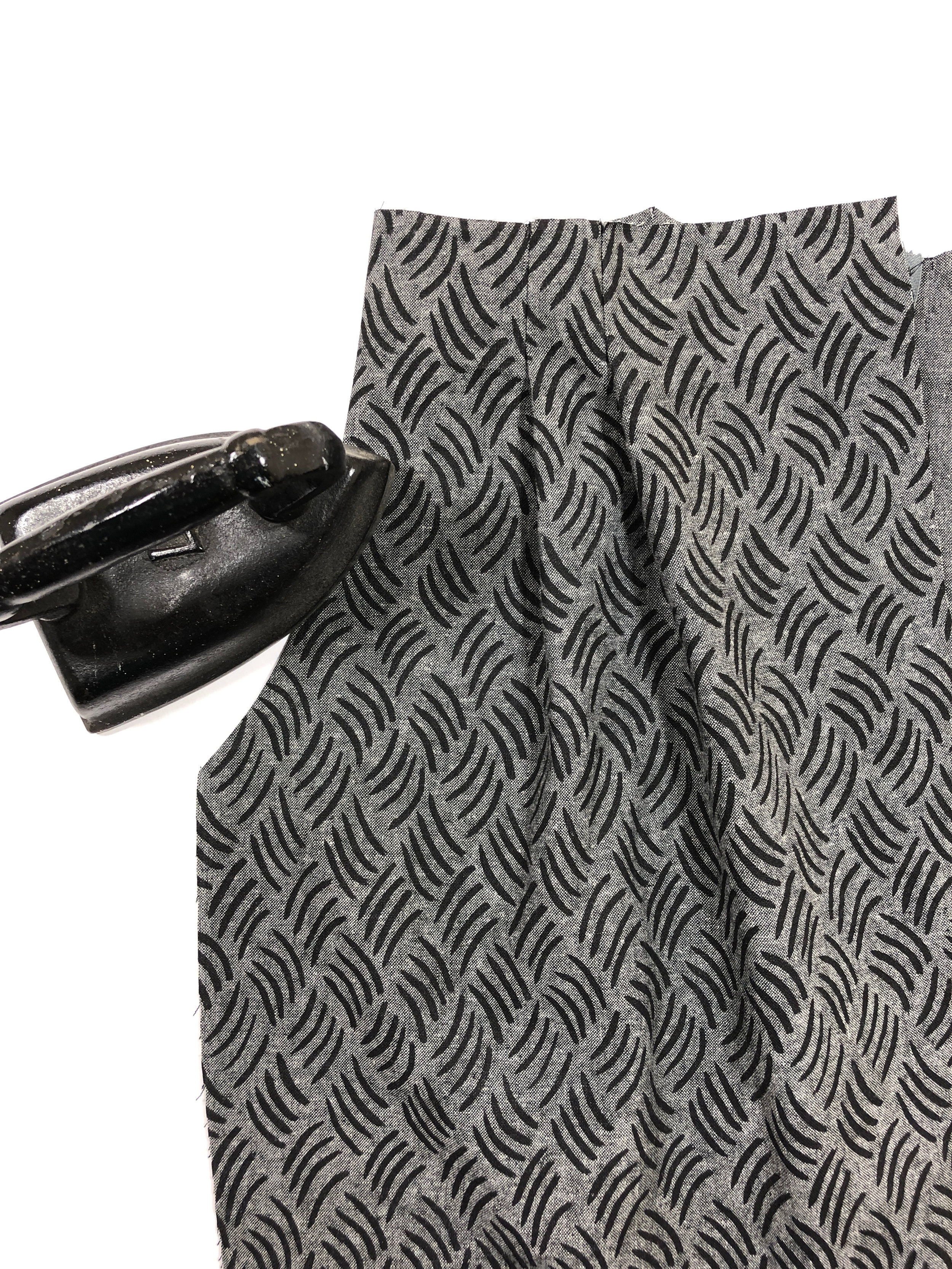 16. Flip the pocket towards the inside of the pant front, and press well.