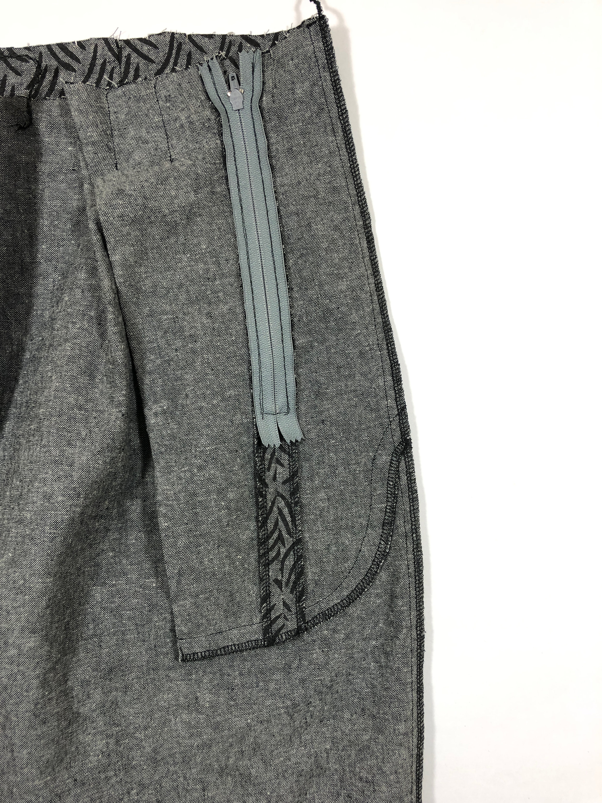 26. Press this seam towards the back pant leg, and serge/finish.  Make sure all these steps are completed on both pant legs before proceeding to the next step.