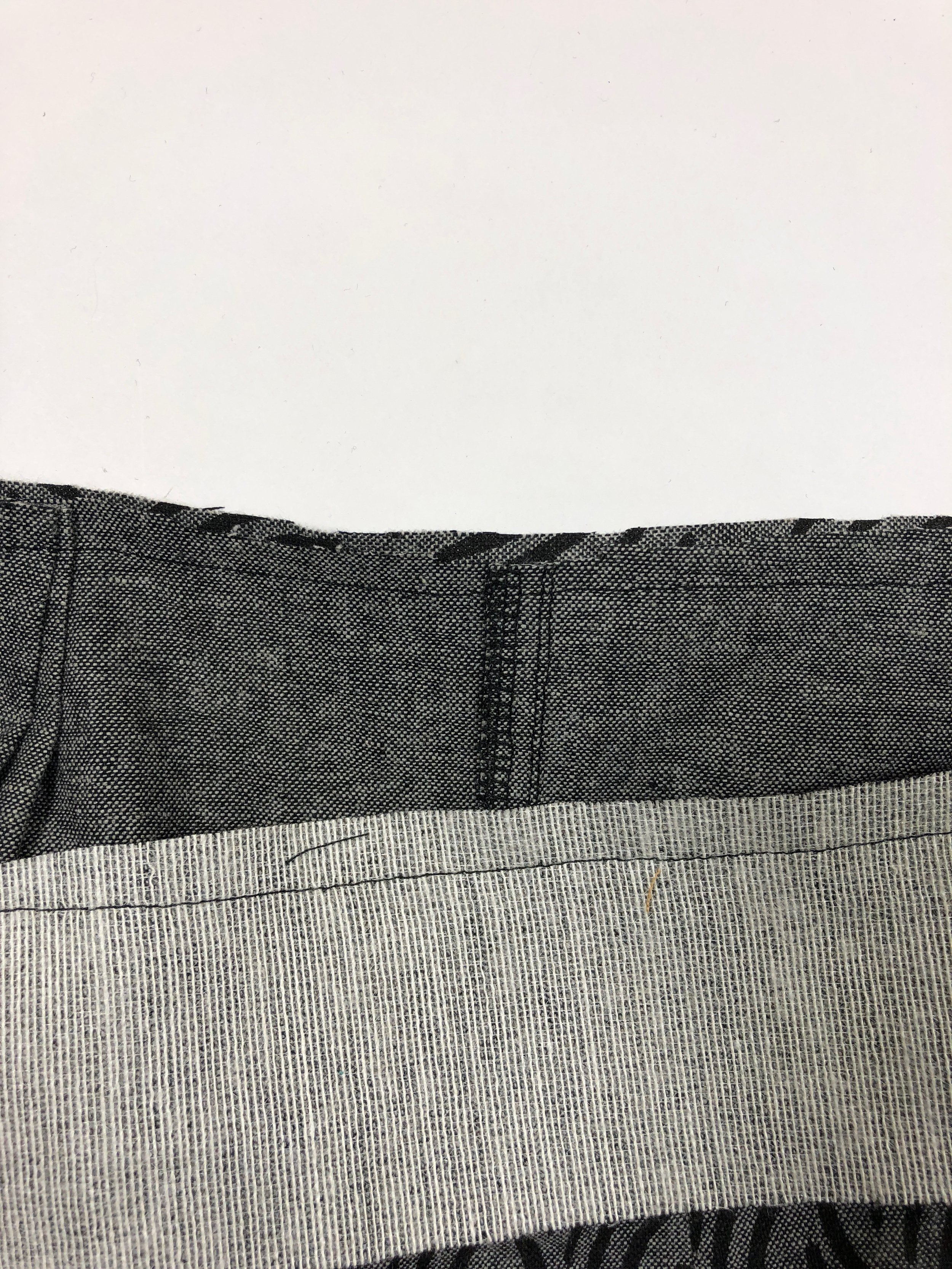 """44. Trim seam allowance to 3/8"""", and grade the pants seam allowance to 1/4""""."""