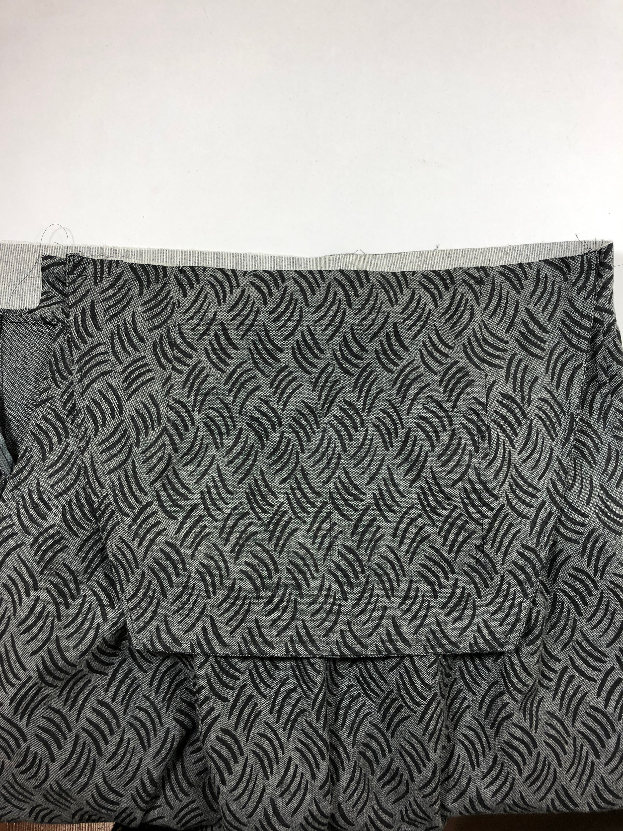 """47. Attach the bib to the top of the waistband, matching center notches. Stitch with 1/2"""" seam allowance.  Skip this step if you are making the Trousers - View B."""