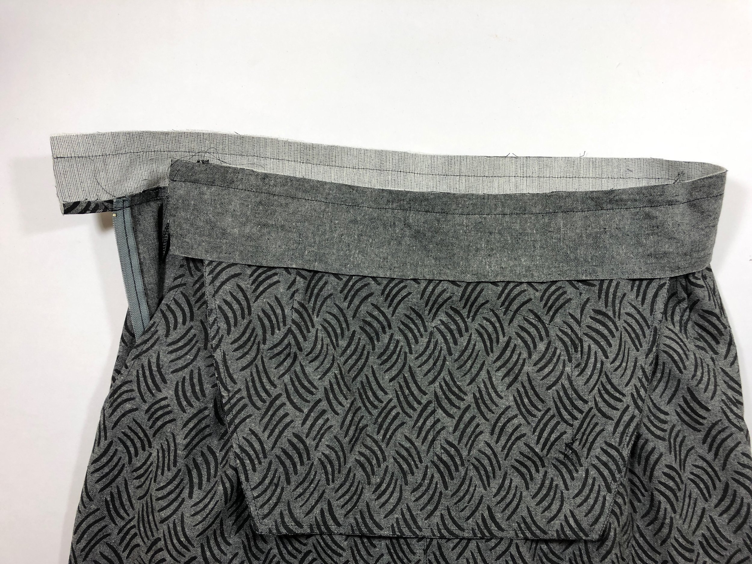 """48. With right sides together, stitch the waistband facing to the waistband with 5/8"""" seam allowance."""
