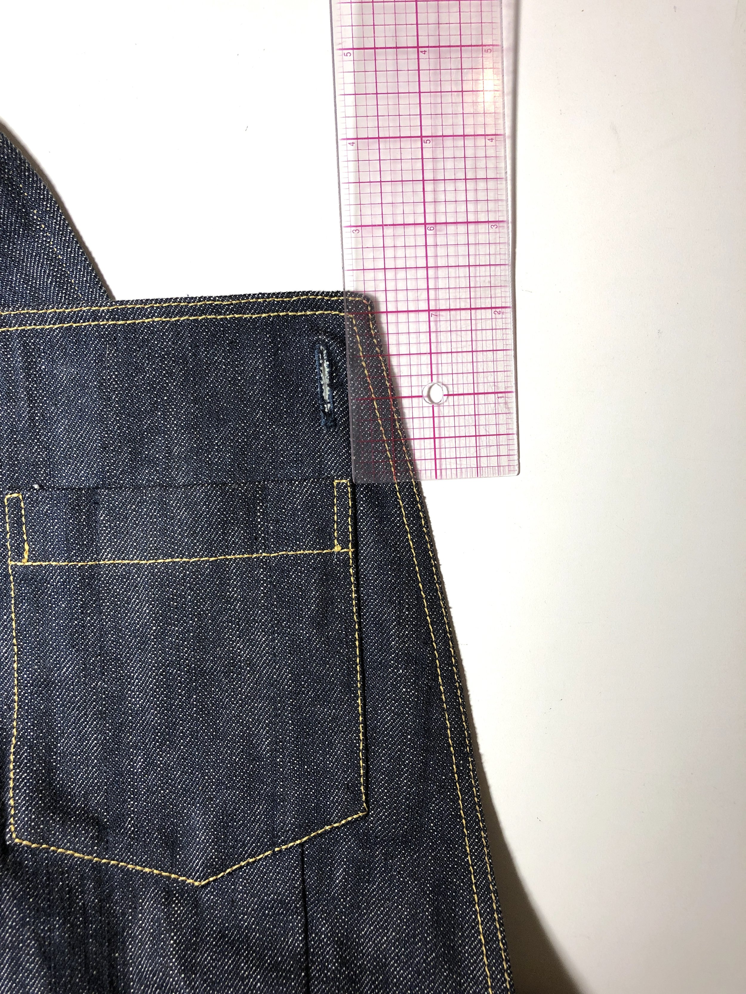 """Bib patch pocket location: about 2"""" down from the top of the bib, and 3/4"""" in from the side. Keep the top of the pocket parallel with the top of the bib."""