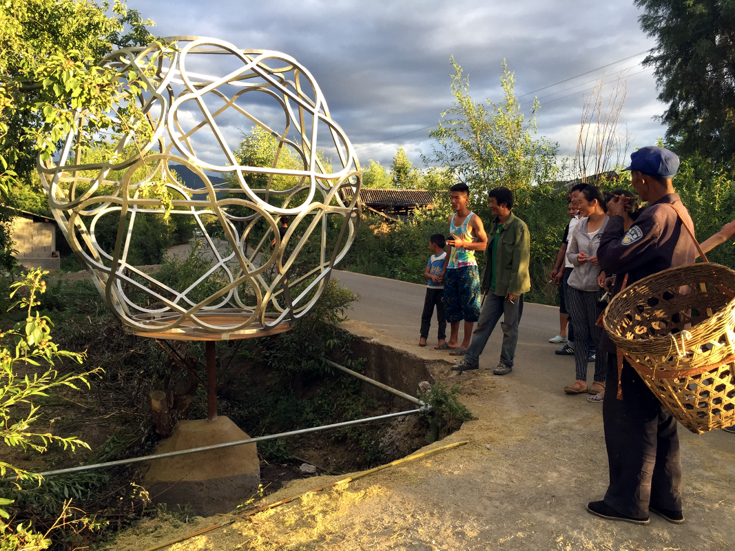20150702: A few villagers gather at Orb Site, moments after installation. // Photo: J. Brown