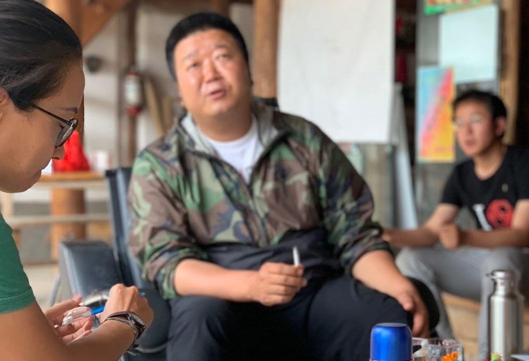 Left to right: Chen Wanrong (Lara); Li Chunping (Head of Ciman Village); He Jixing